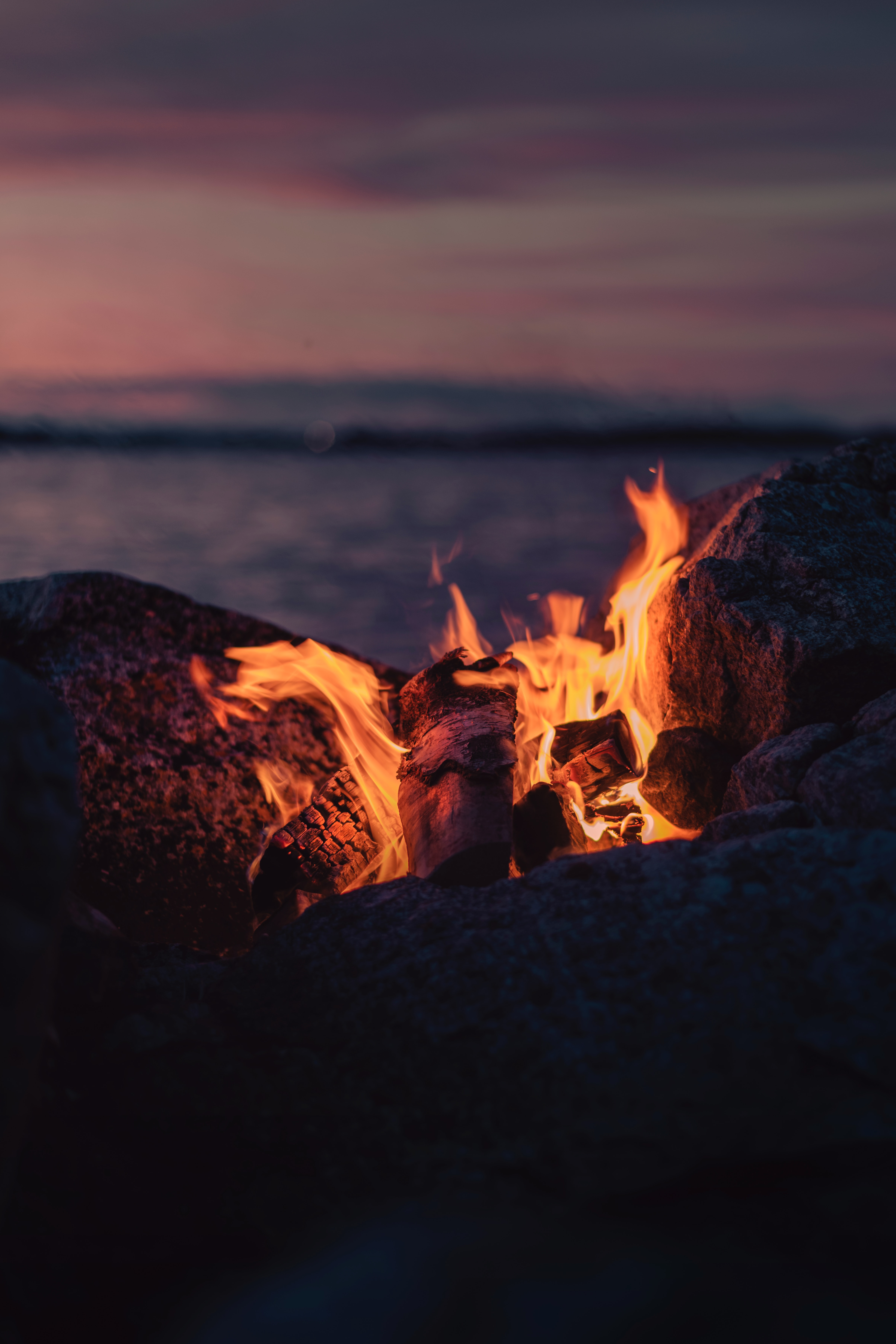 114587 Screensavers and Wallpapers Firewood for phone. Download Stones, Fire, Bonfire, Dark, Flame, Firewood pictures for free