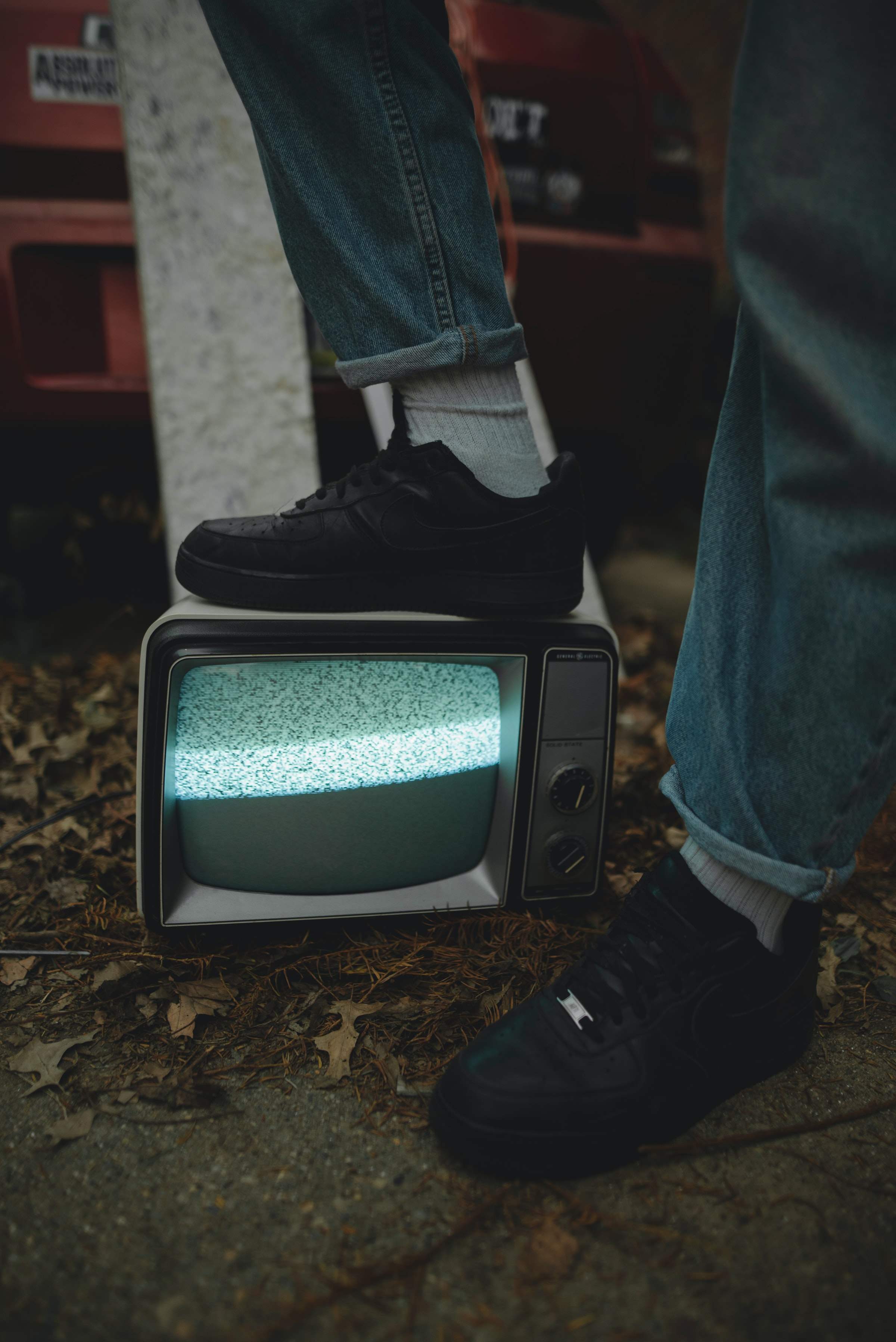 121919 download wallpaper Miscellanea, Miscellaneous, Legs, Sneakers, Screen, Television, Television Set, Jeans screensavers and pictures for free