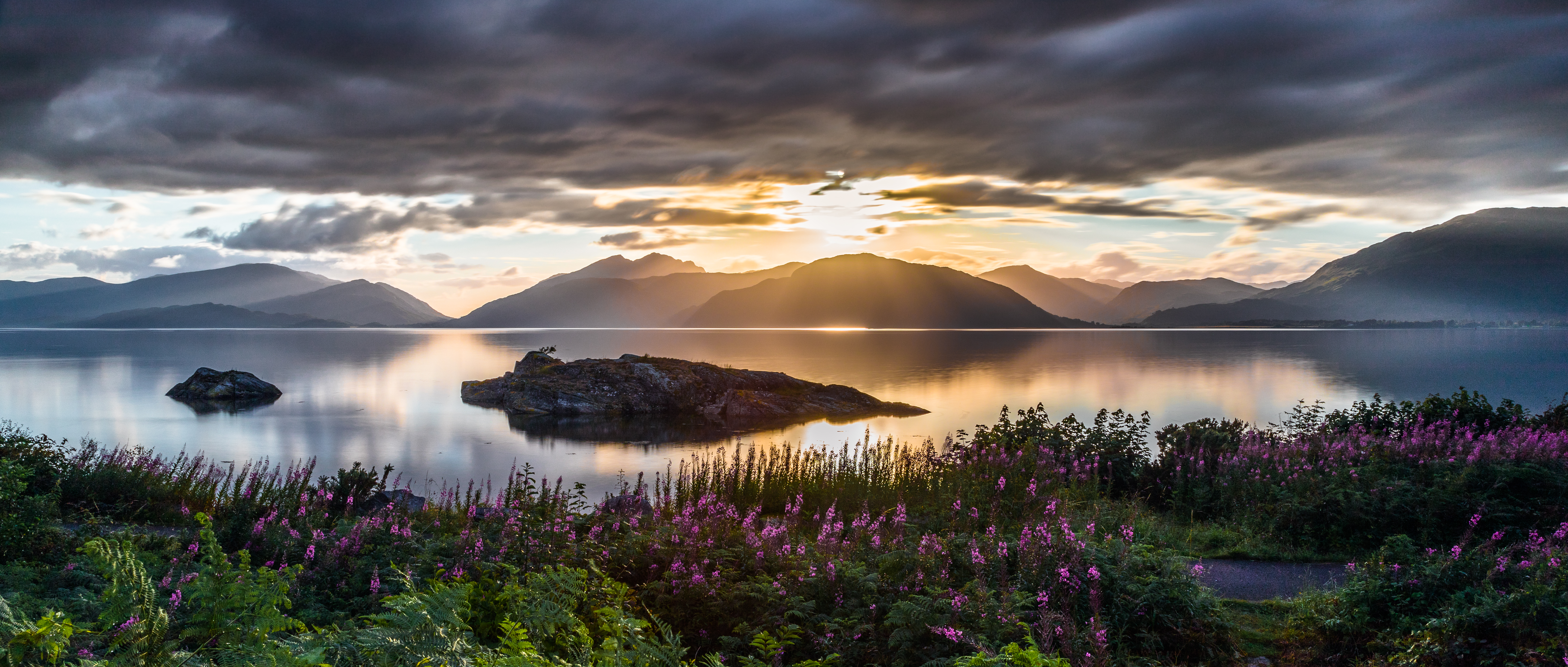 61086 download wallpaper Nature, Sea, Sunset, Sky, Mountains, Flowers screensavers and pictures for free
