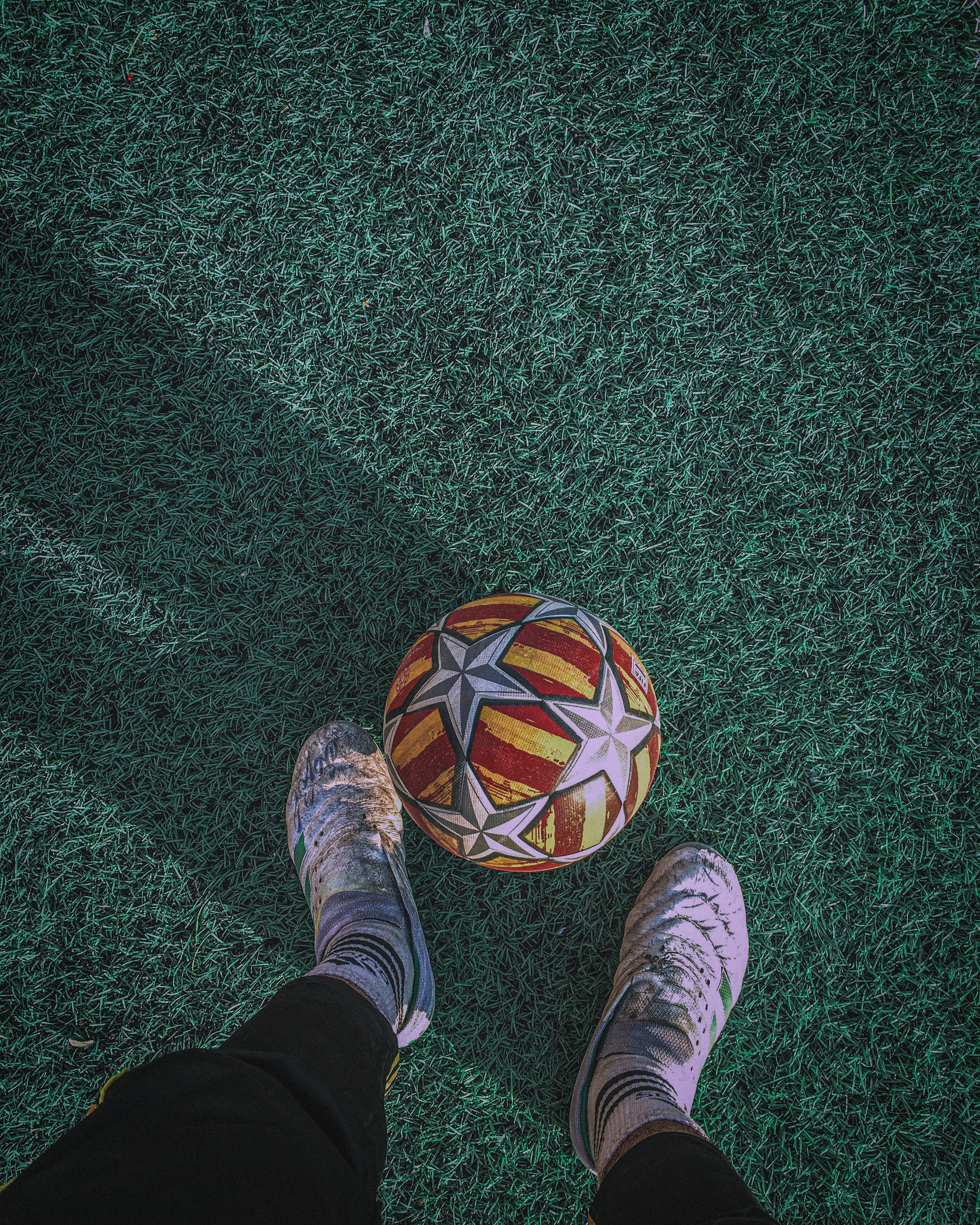 101436 download wallpaper Sports, Ball, Legs, Football, Lawn screensavers and pictures for free