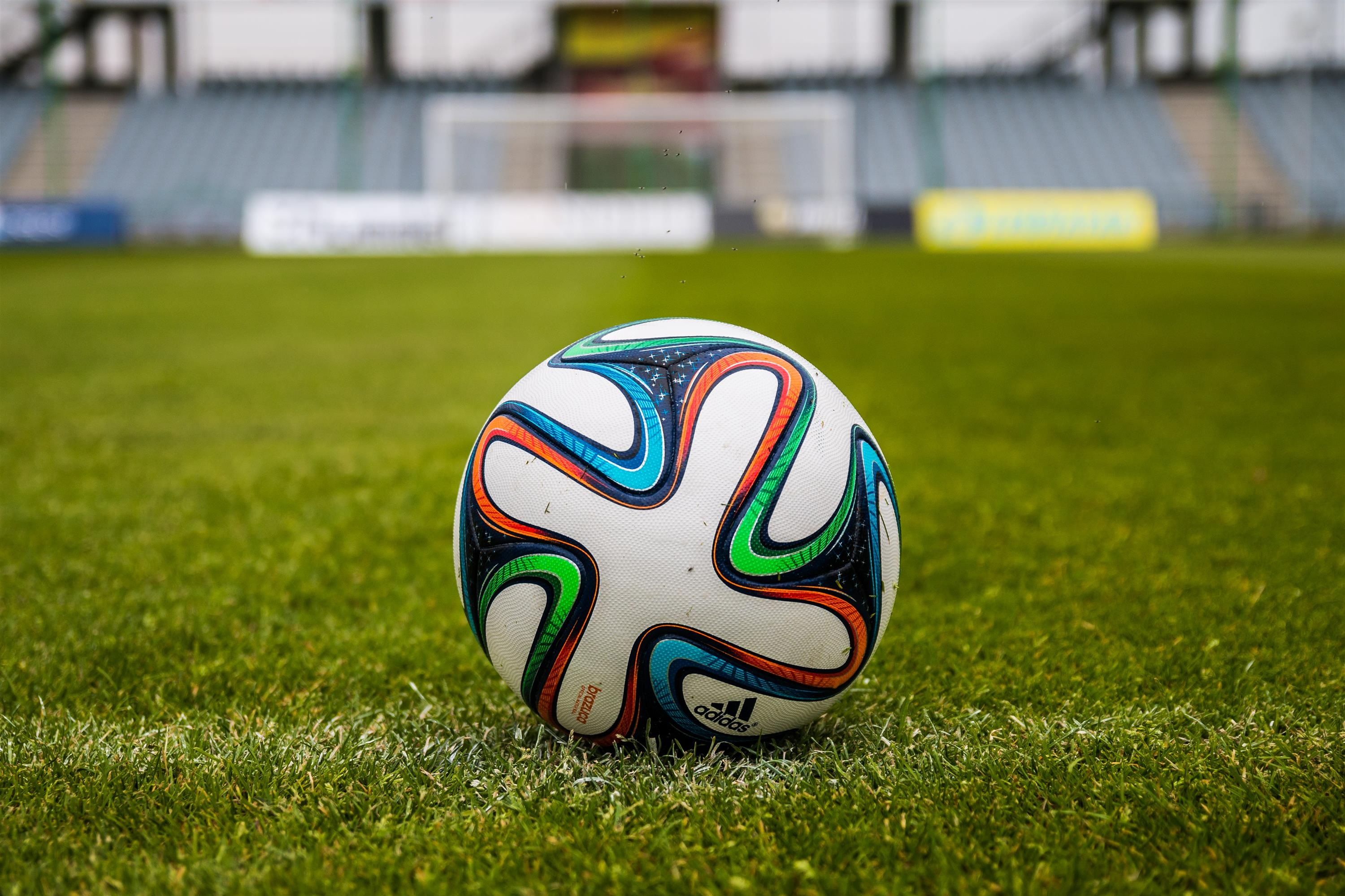 51254 download wallpaper Sports, Ball, Football, Field, Grass screensavers and pictures for free