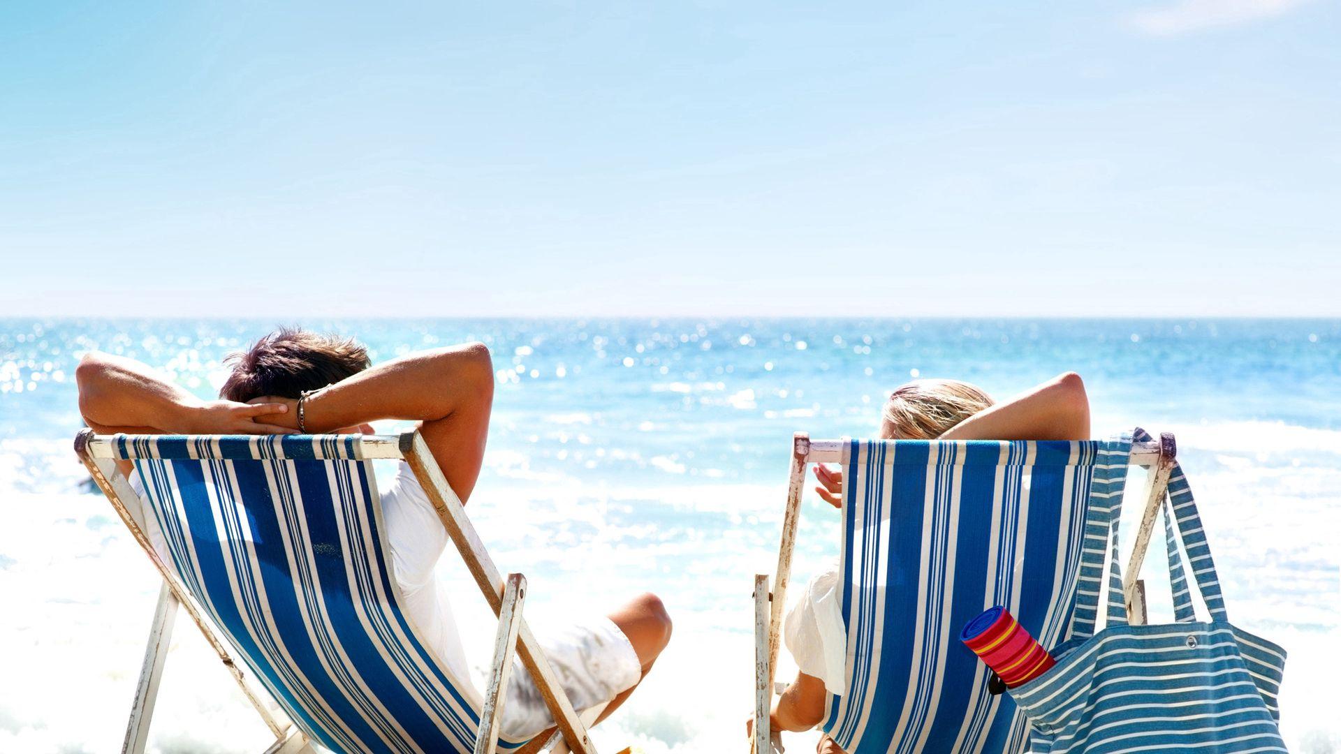 136989 download wallpaper Miscellanea, Miscellaneous, Sun Loungers, Sun Beds, Couple, Pair, Sunbathe, Beach, Sea, Sand, Sun screensavers and pictures for free