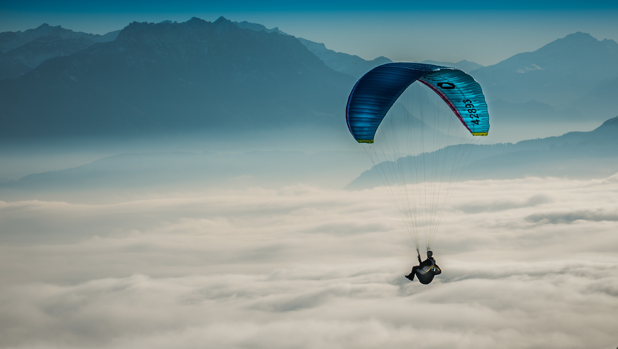 59025 download wallpaper Sports, Sky, Clouds, Paragliding, Paraglider screensavers and pictures for free