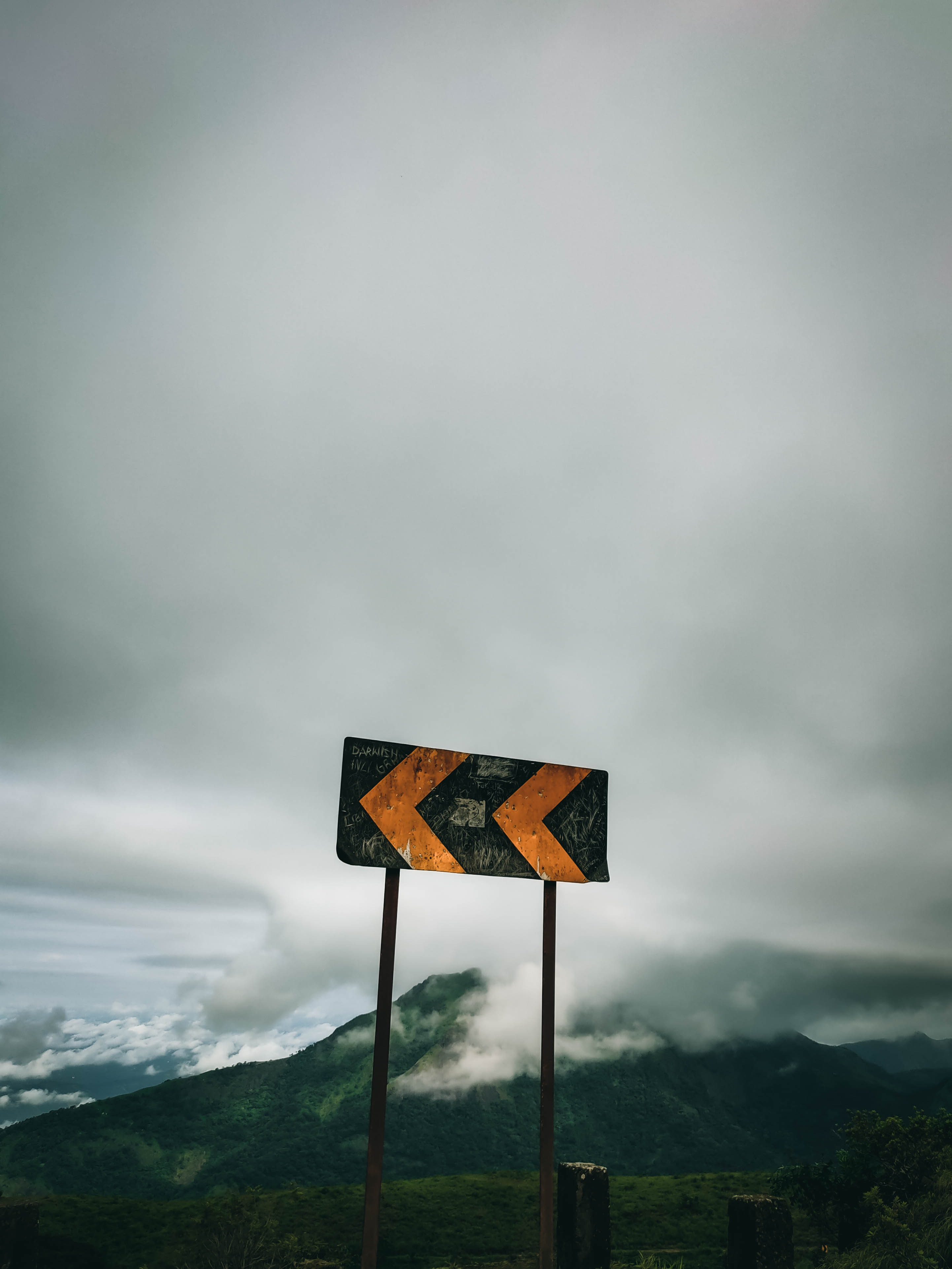 137580 download wallpaper Miscellanea, Miscellaneous, Sign, Arrow, Clouds, Mountains screensavers and pictures for free