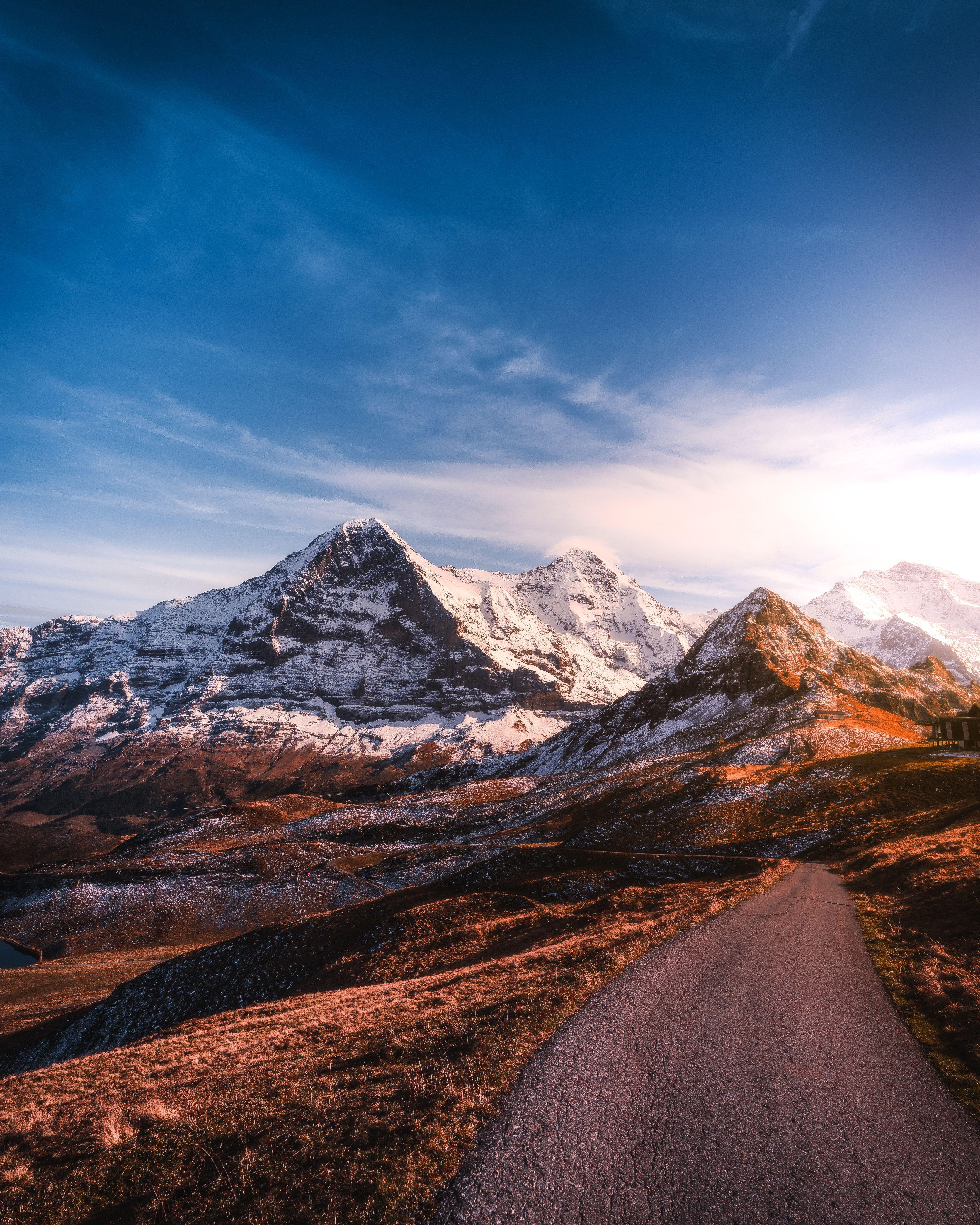 72844 обои 720x1280 на телефон бесплатно, скачать картинки Асфальт, Горы, Швейцария, Природа, Небо, Дорога, Вершины, Заснеженный 720x1280 на мобильный