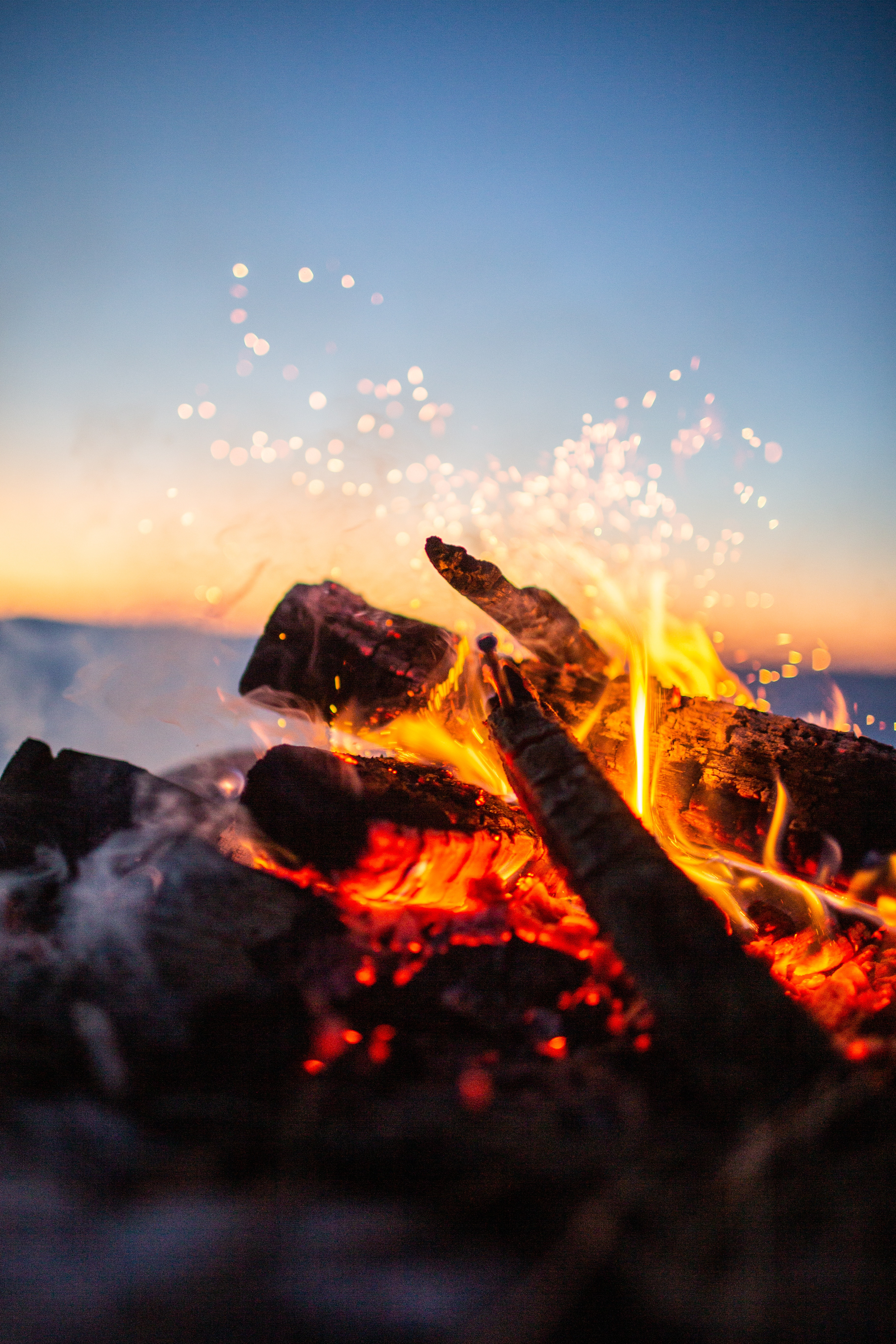 155336 Screensavers and Wallpapers Bonfire for phone. Download Blur, Camping, Fire, Bonfire, Sparks, Miscellanea, Miscellaneous, Smooth, Firewood, Campsite pictures for free