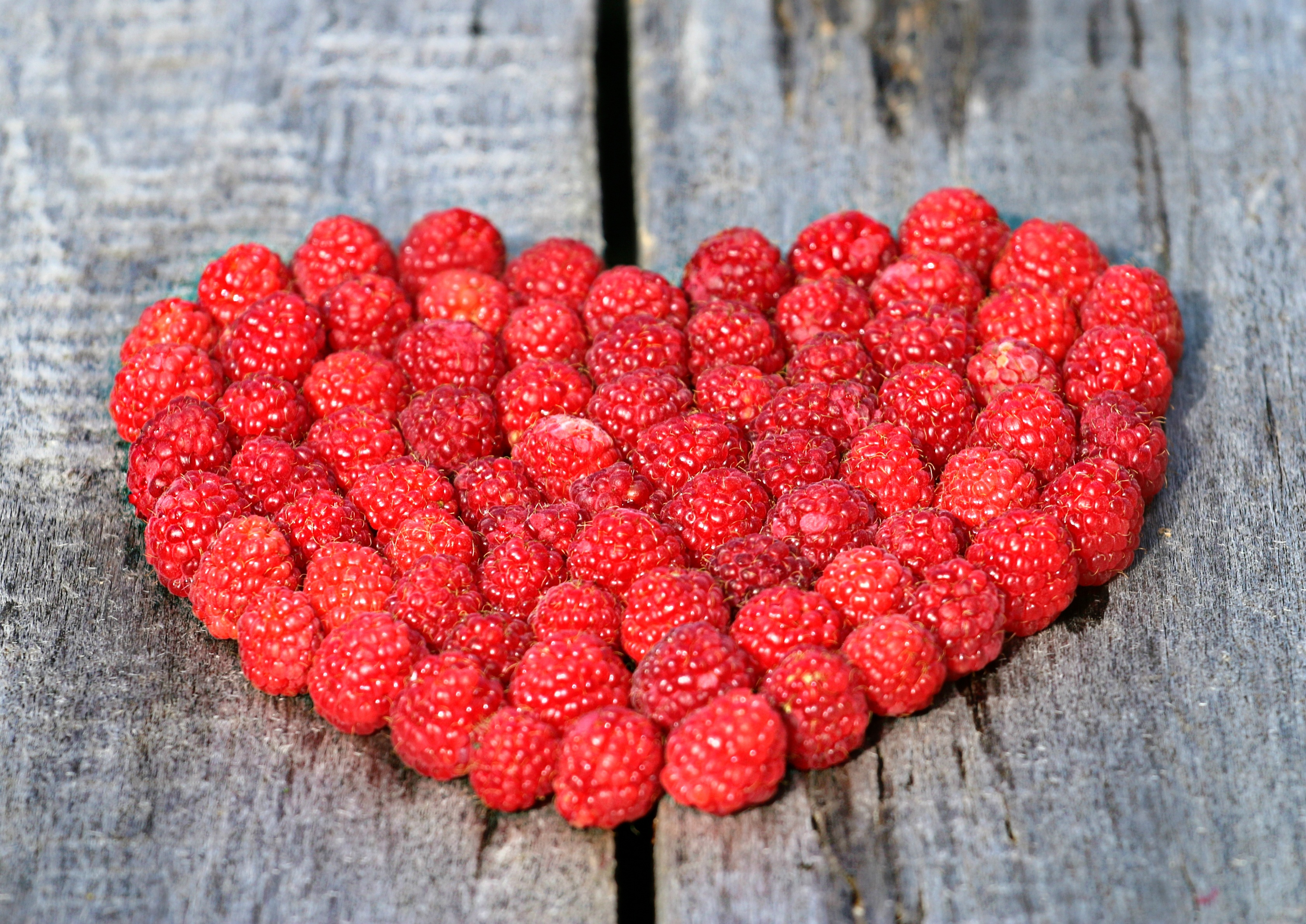 128143 download wallpaper Food, Raspberry, Heart, Wood Surface, Wooden Surface, Berries screensavers and pictures for free