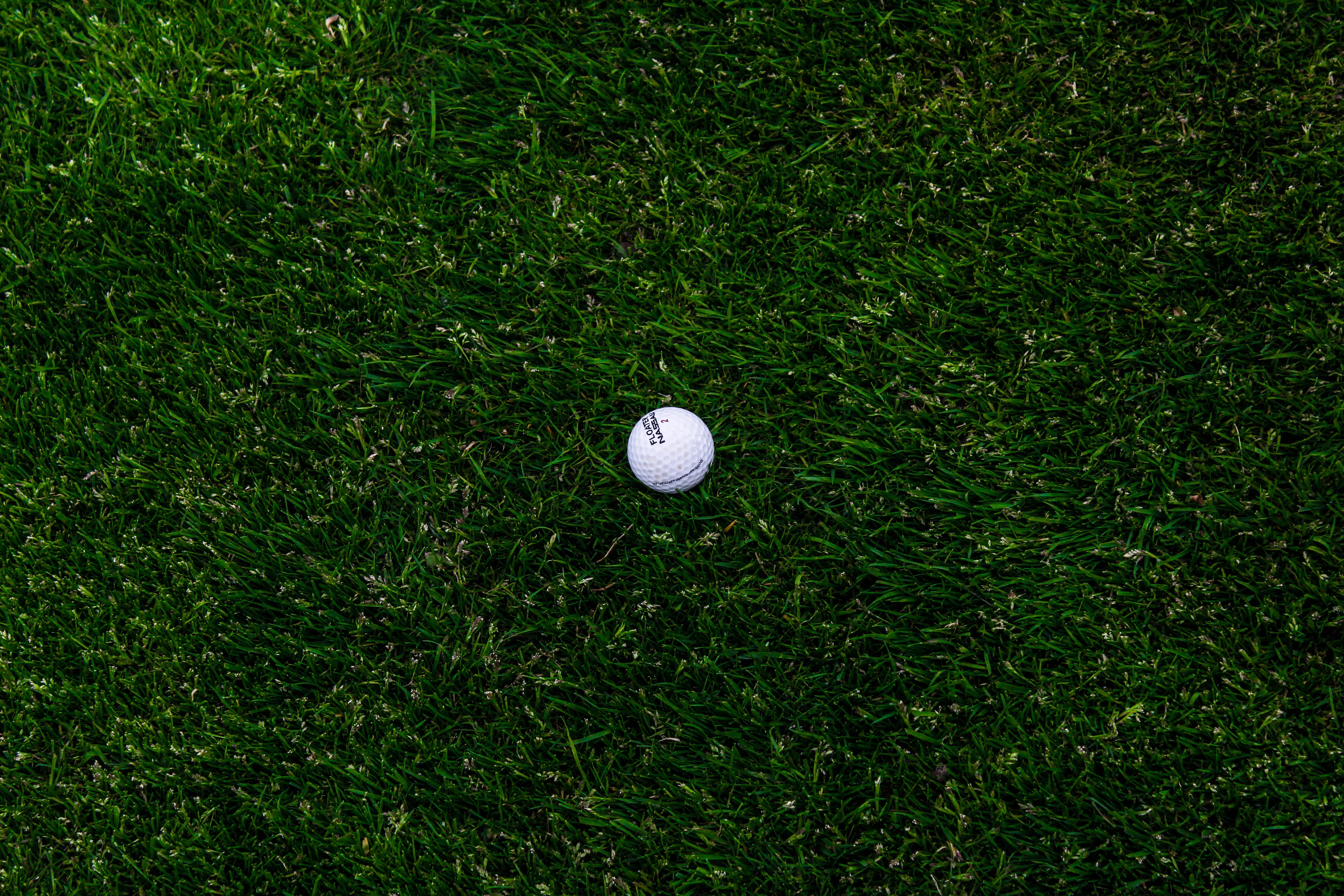 142790 download wallpaper Grass, Golf, Minimalism, Ball, Lawn screensavers and pictures for free