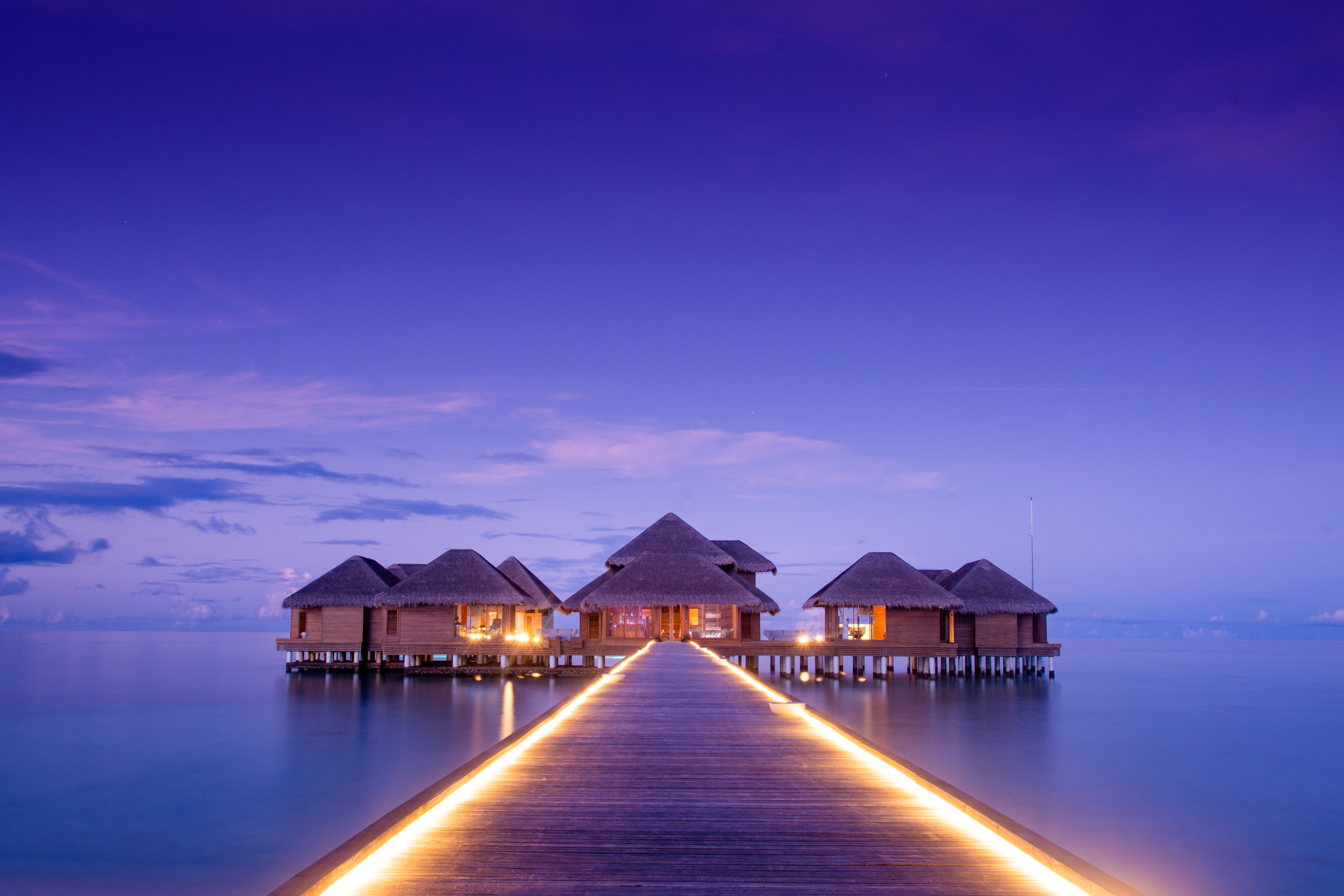101747 download wallpaper Miscellanea, Building, Pier, Miscellaneous, Ocean, Backlight, Illumination, Bungalow screensavers and pictures for free