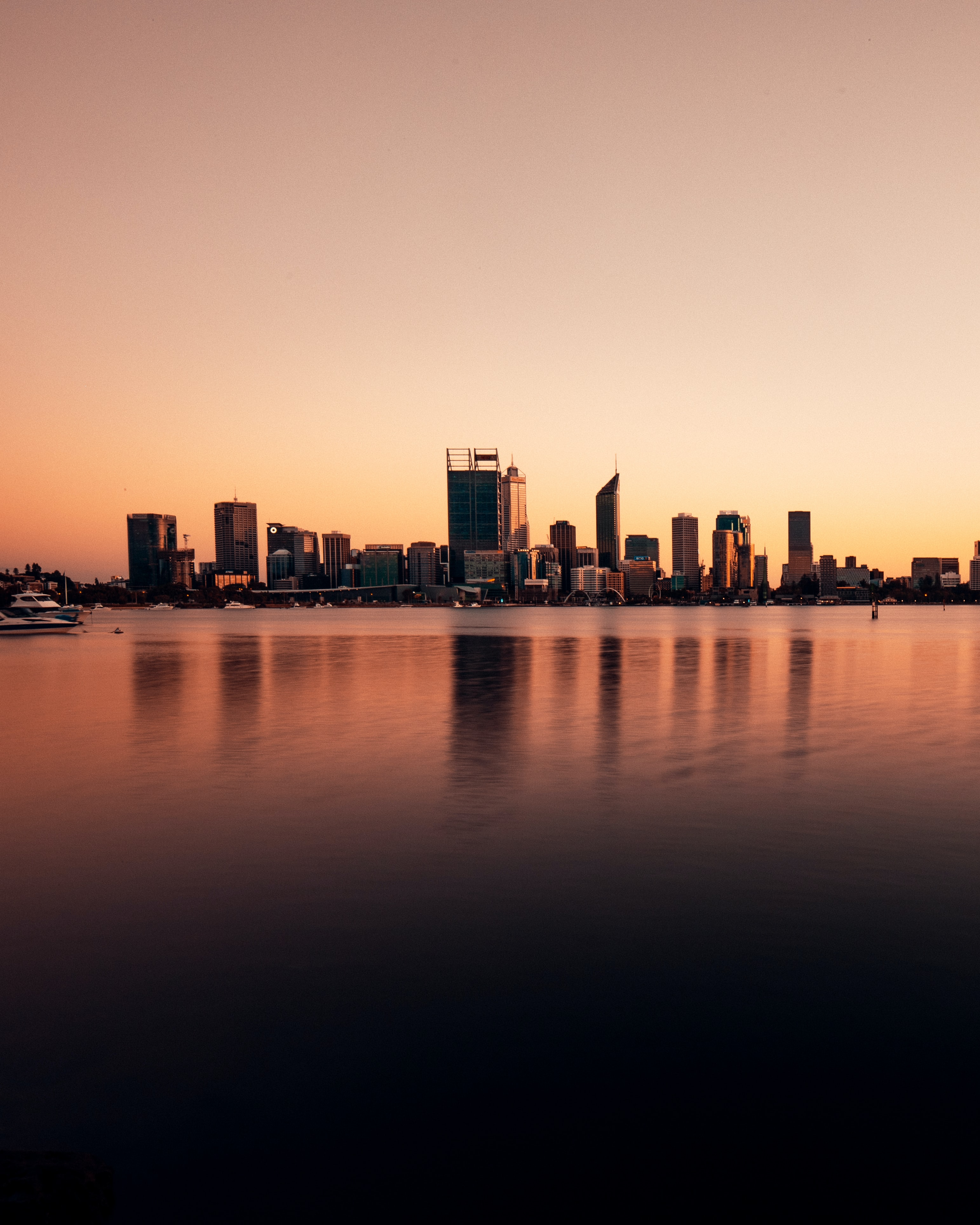 154727 download wallpaper Building, City, Reflection, Water, Sky, Dusk, Twilight, Cities screensavers and pictures for free