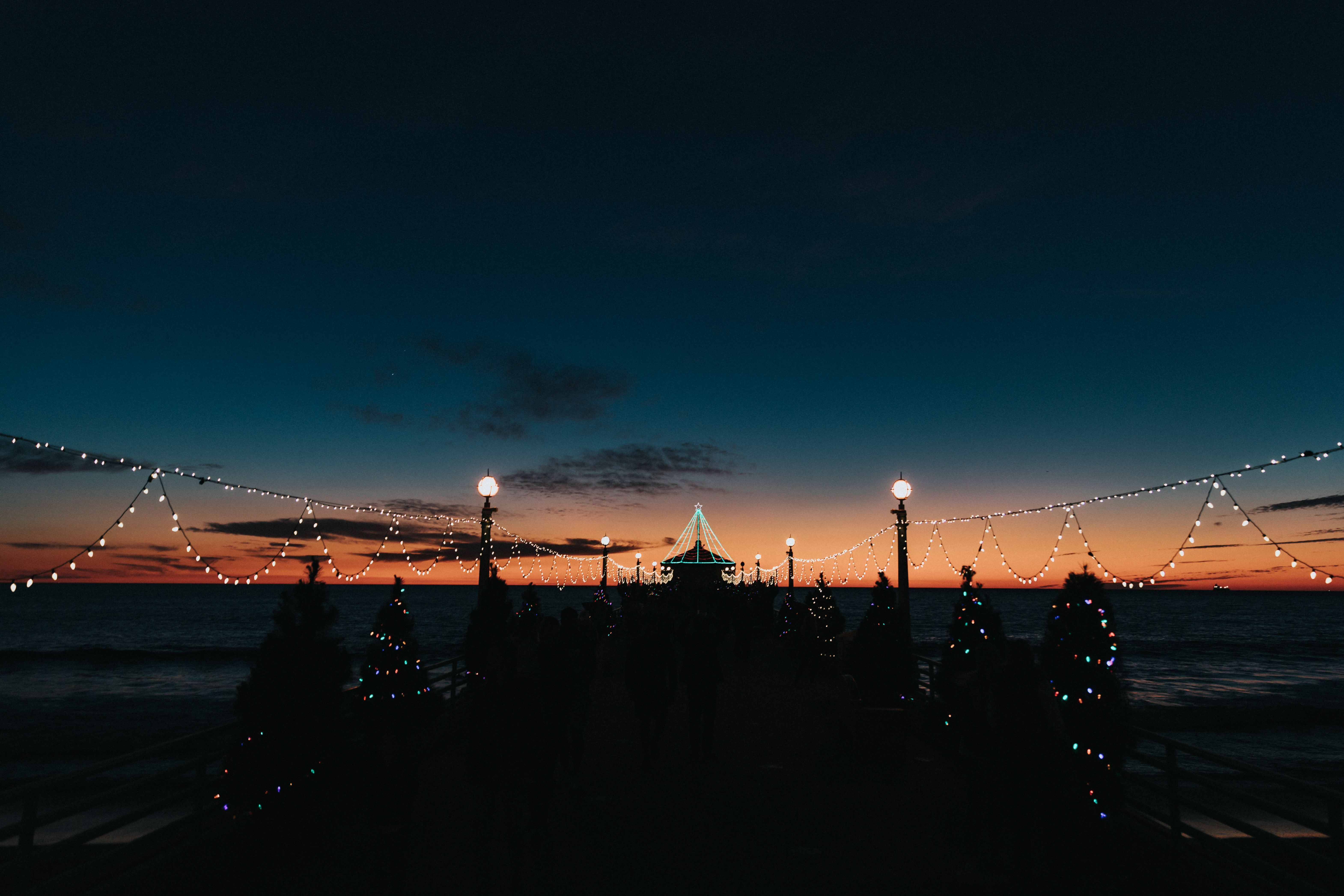 132363 Screensavers and Wallpapers Dark for phone. Download Dark, Pier, Garlands, Garland, Lights, Silhouettes pictures for free