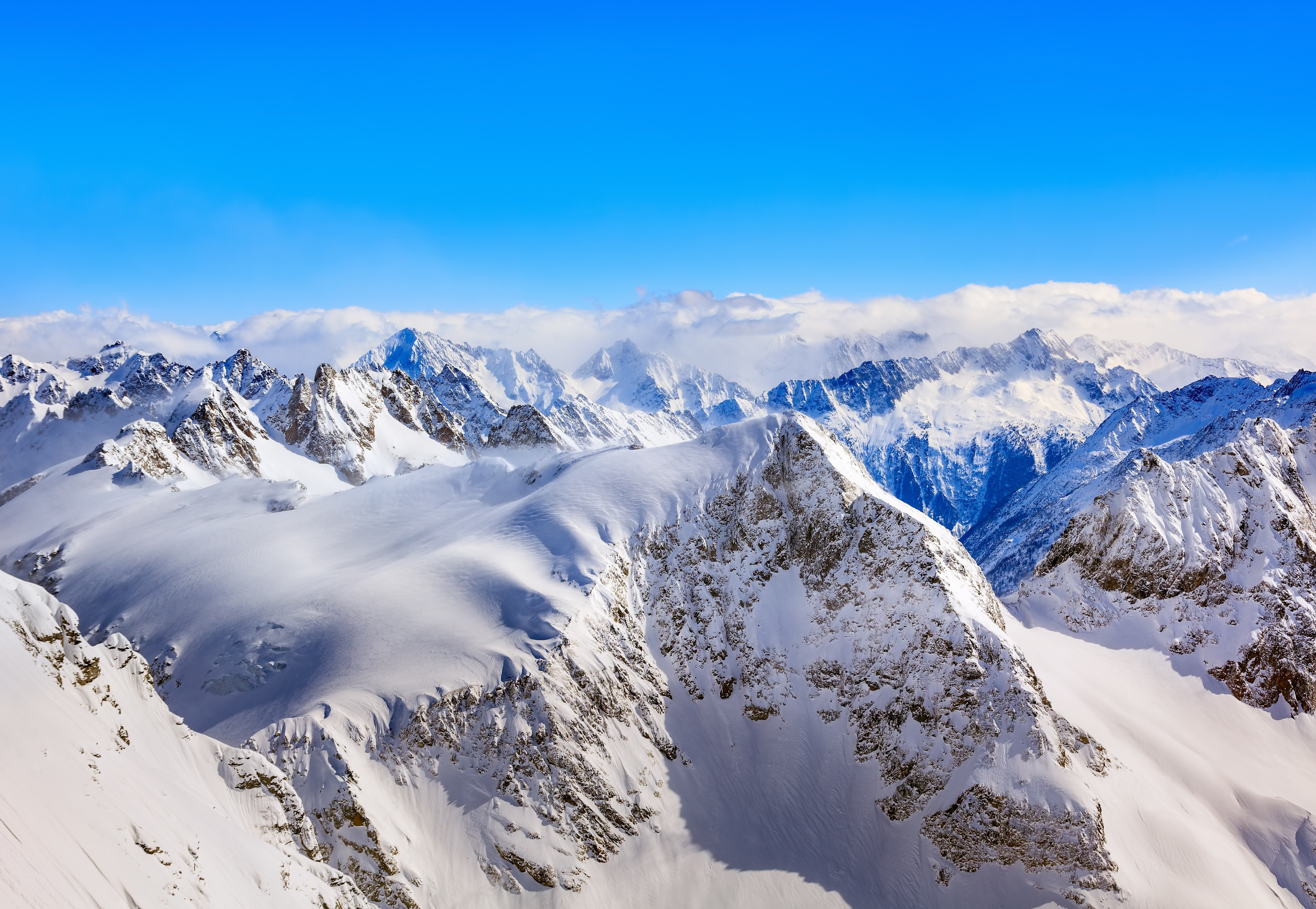 149489 download wallpaper Nature, Winter, Tops, Vertex, Snow Covered, Snowbound, Mountains screensavers and pictures for free