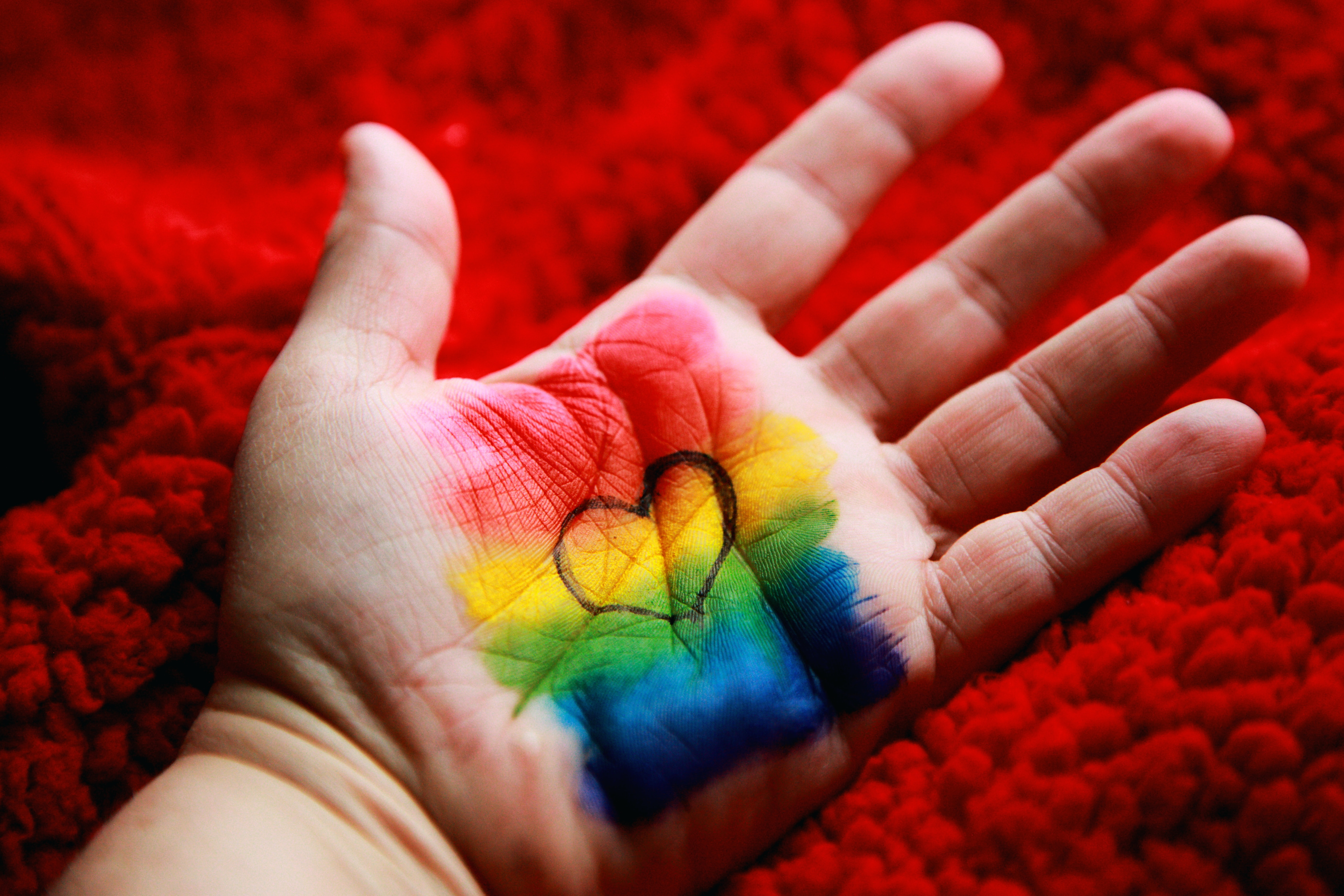 124282 download wallpaper Rainbow, Love, Hand, Multicolored, Motley, Paint, Heart screensavers and pictures for free