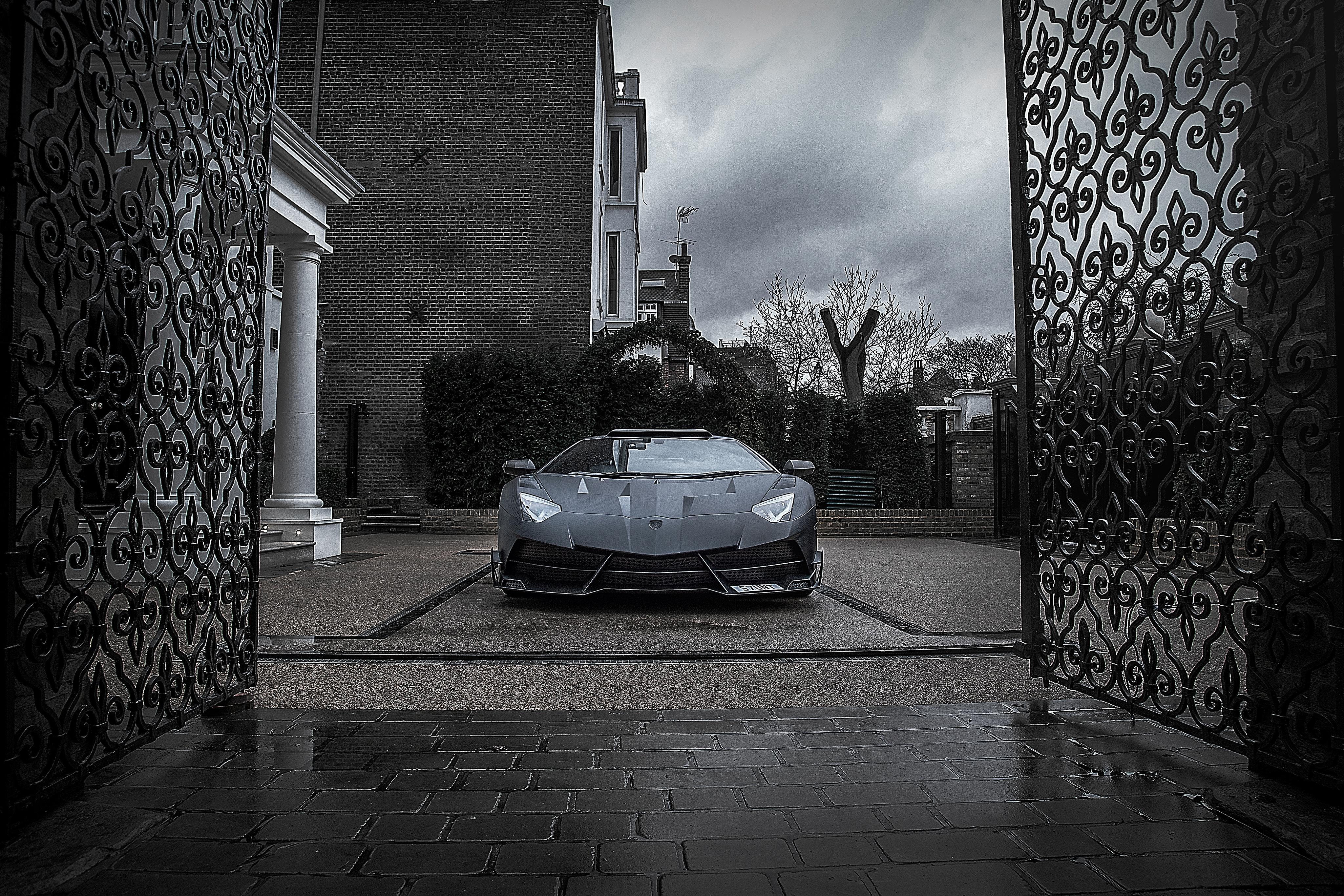 143610 Заставки и Обои Вид Спереди на телефон. Скачать Ламборджини (Lamborghini), Черный, Вид Спереди, Тачки (Cars), Aventador, Mansory, Ворота картинки бесплатно