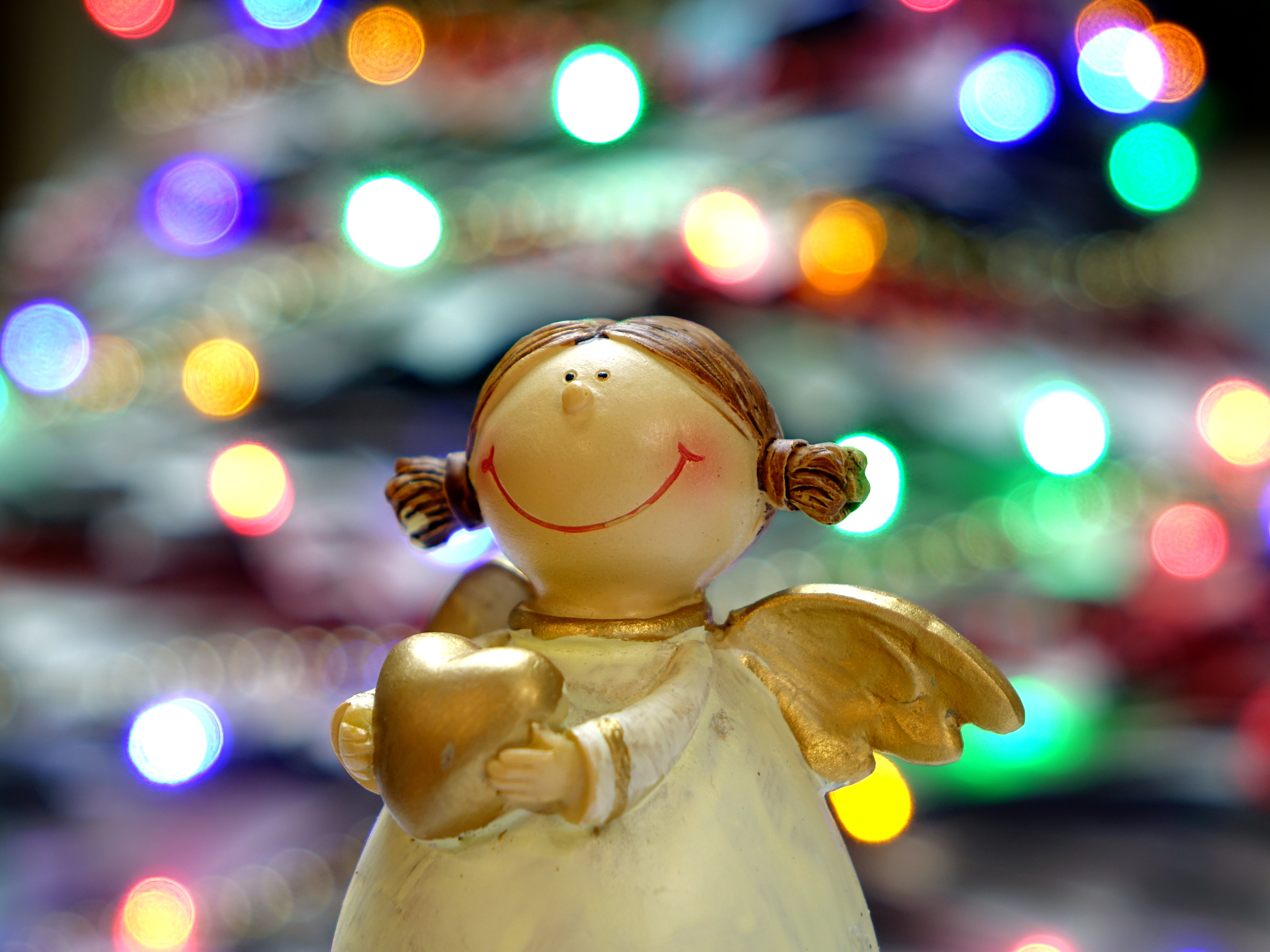 60811 download wallpaper Holidays, Angel, Christmas, Glare, Statuette screensavers and pictures for free