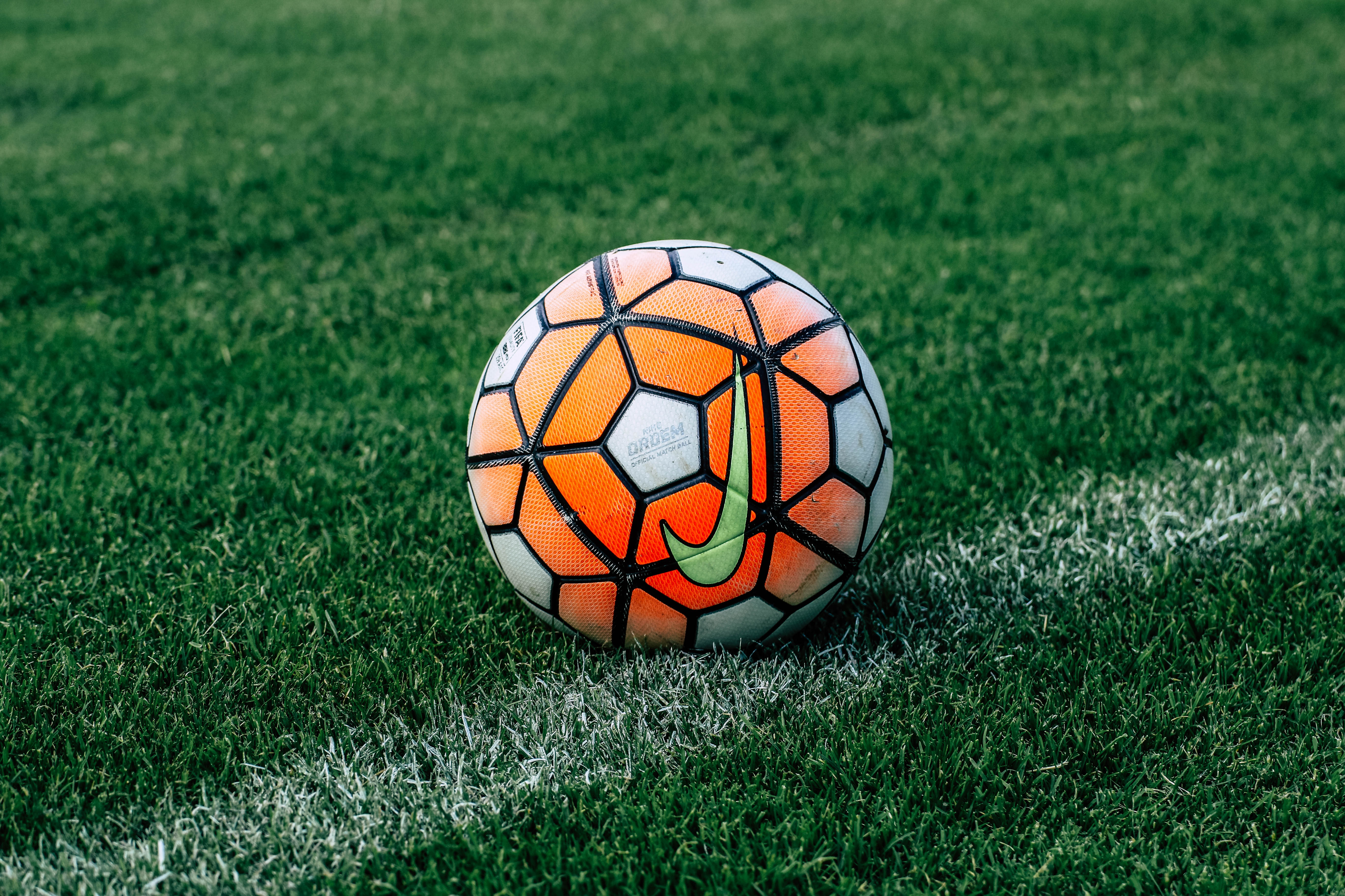 114970 download wallpaper Sports, Football, Grass, Lawn, Soccer Ball screensavers and pictures for free