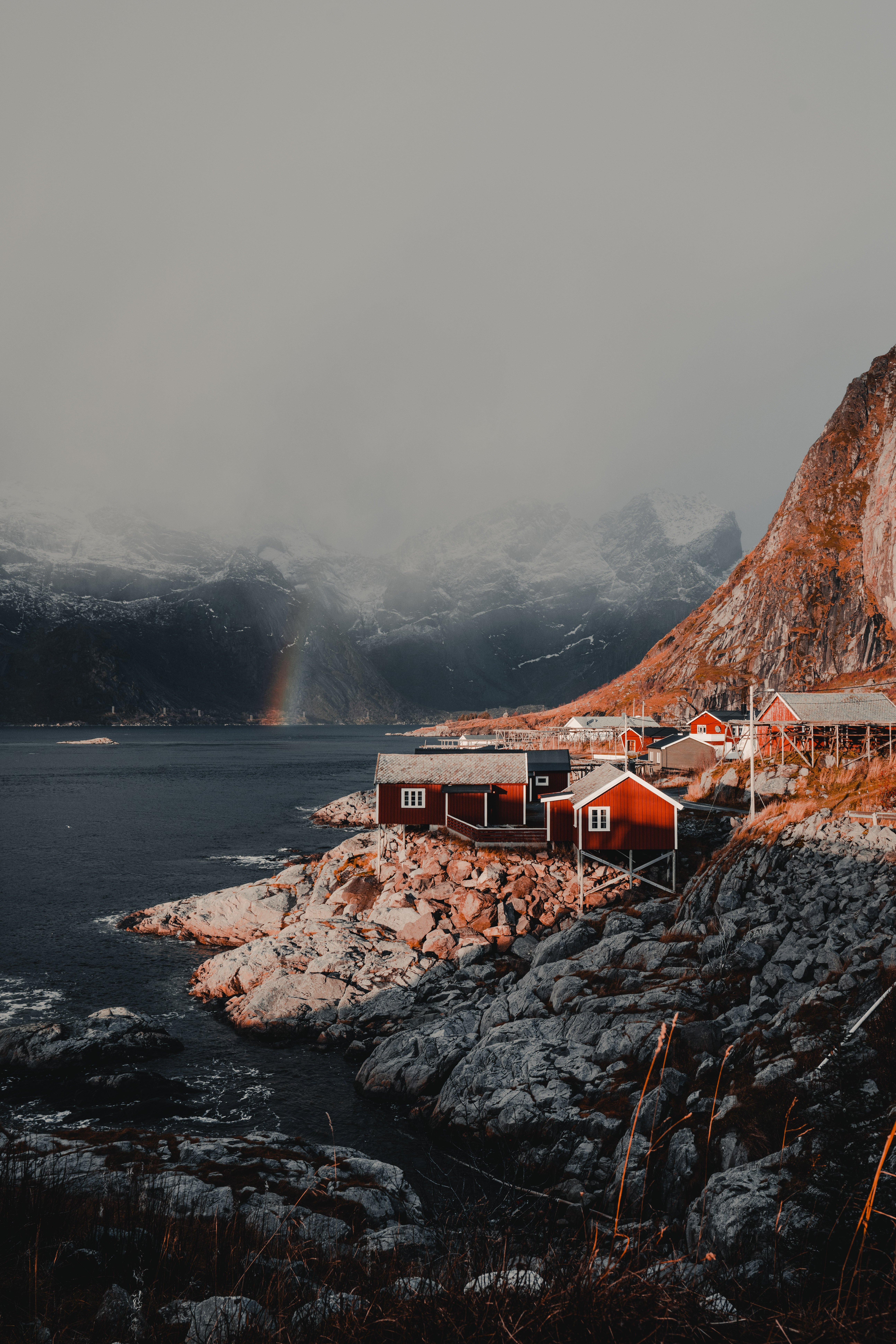 146496 download wallpaper Nature, Houses, Mountains, Rainbow, Fog, Norway, Small Houses, Lofoten Islands screensavers and pictures for free