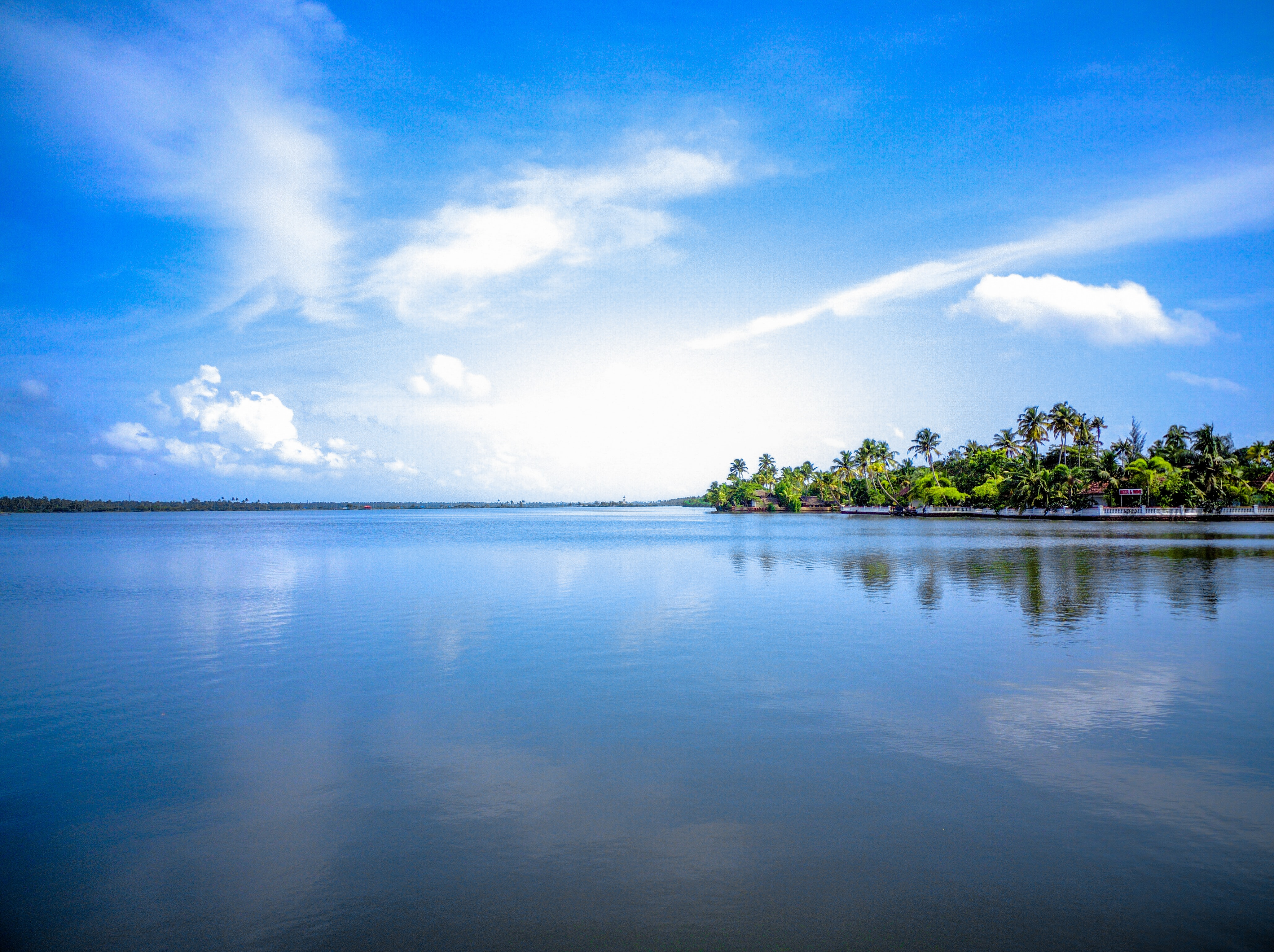 151348 download wallpaper Nature, Sky, Palms, Island, Cloud screensavers and pictures for free