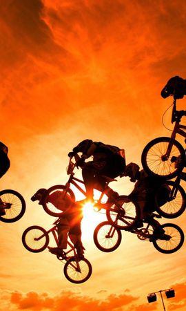 123063 Заставки и Обои Солнце на телефон. Скачать Спорт, Велосипедисты, Небо, Закат, Солнце картинки бесплатно