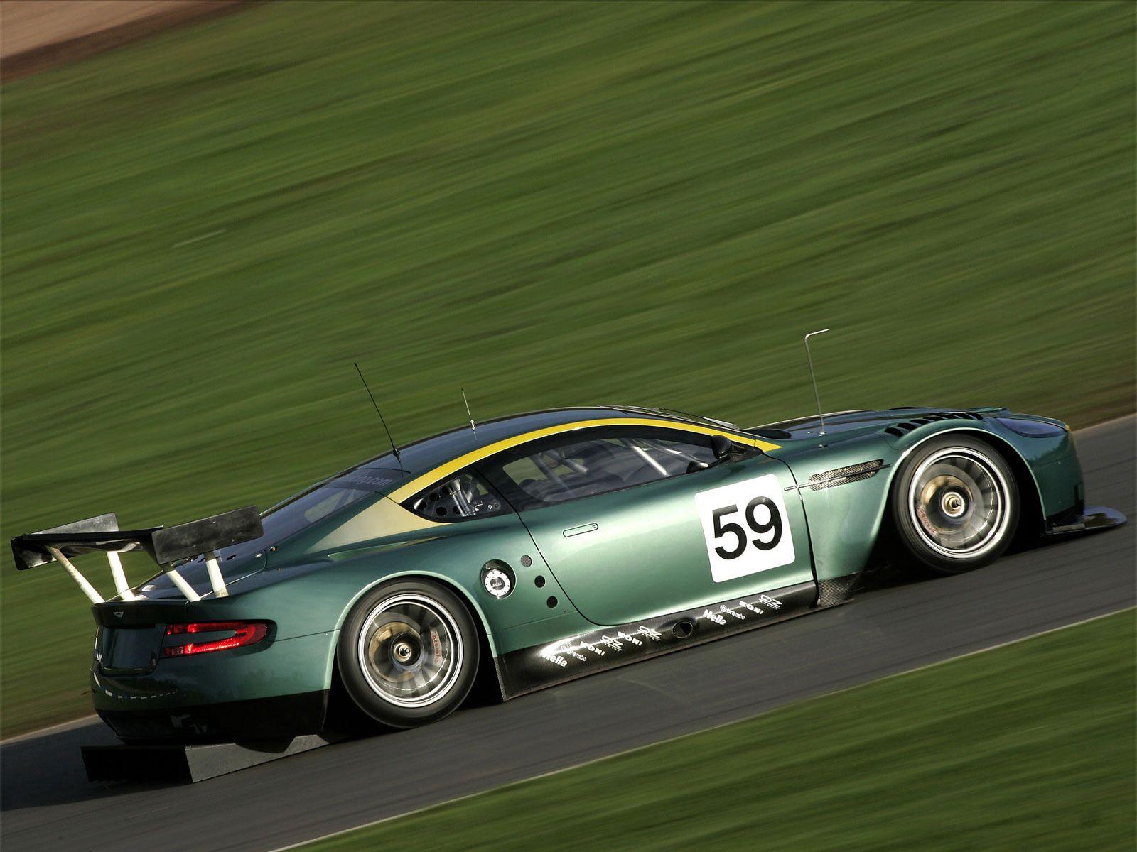 144172 скачать обои Спорт, Машины, Трава, Астон Мартин (Aston Martin), Тачки (Cars), Зеленый, Вид Сбоку, Скорость, Стиль, 2005, Dbr9 - заставки и картинки бесплатно