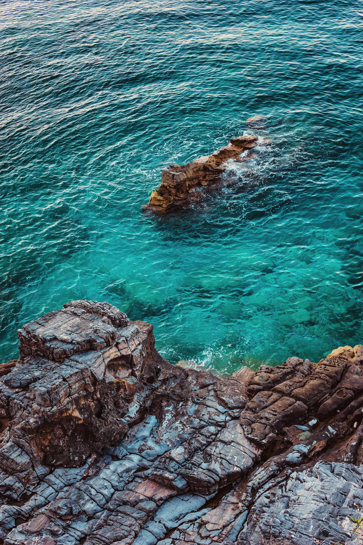152984 免費下載壁紙 性质, 海, 石头, 岩石, 从上面看, 顶视图, 水, 海岸 屏保和圖片
