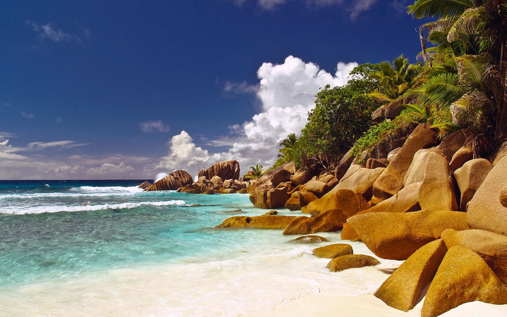 86647 download wallpaper Nature, Stones, Boulders, Shore, Bank, Beach, Blue Water, Tropics, Palms screensavers and pictures for free