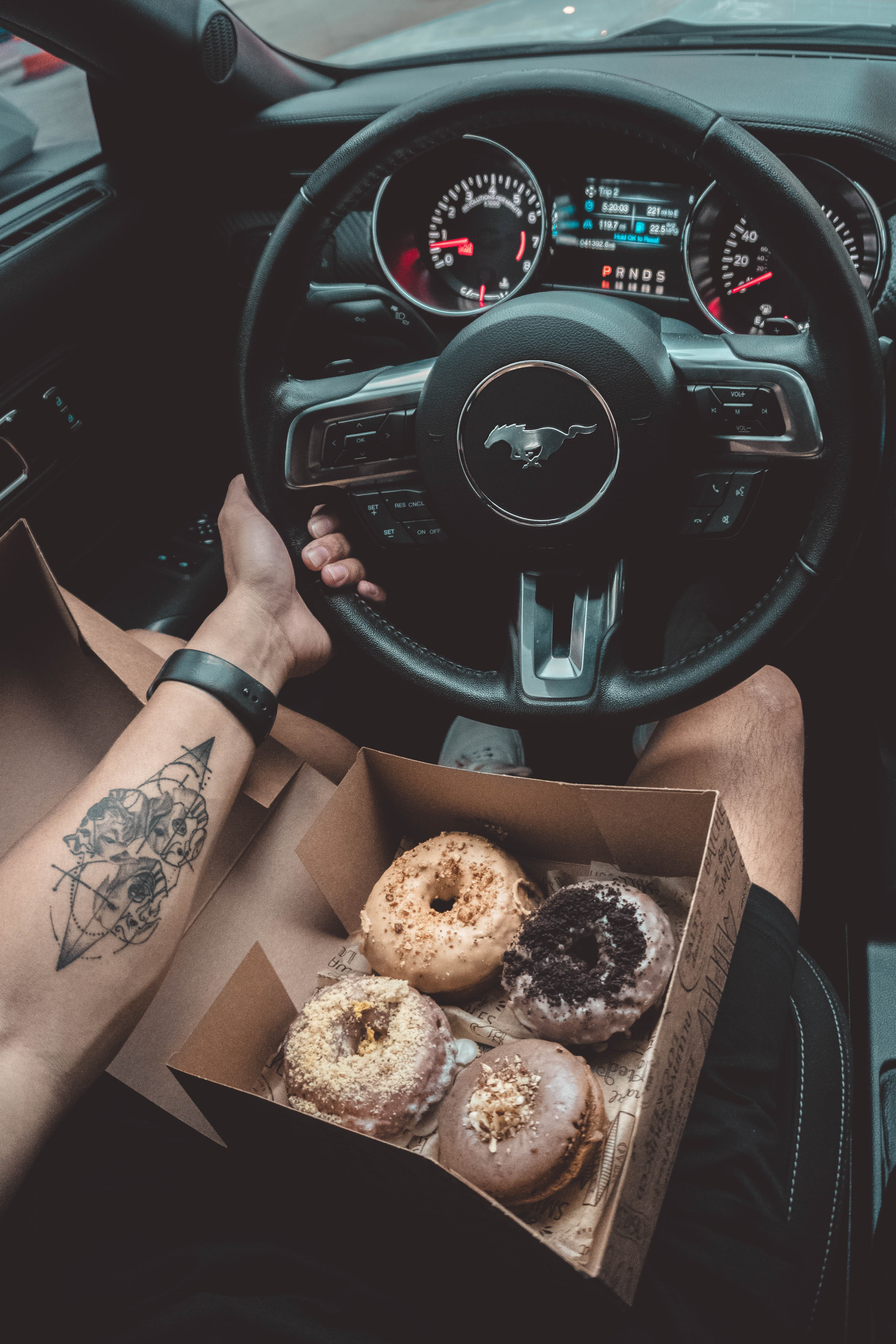 126328 download wallpaper Cars, Hand, Car, Machine, Tattoo, Steering Wheel, Rudder, Donuts screensavers and pictures for free