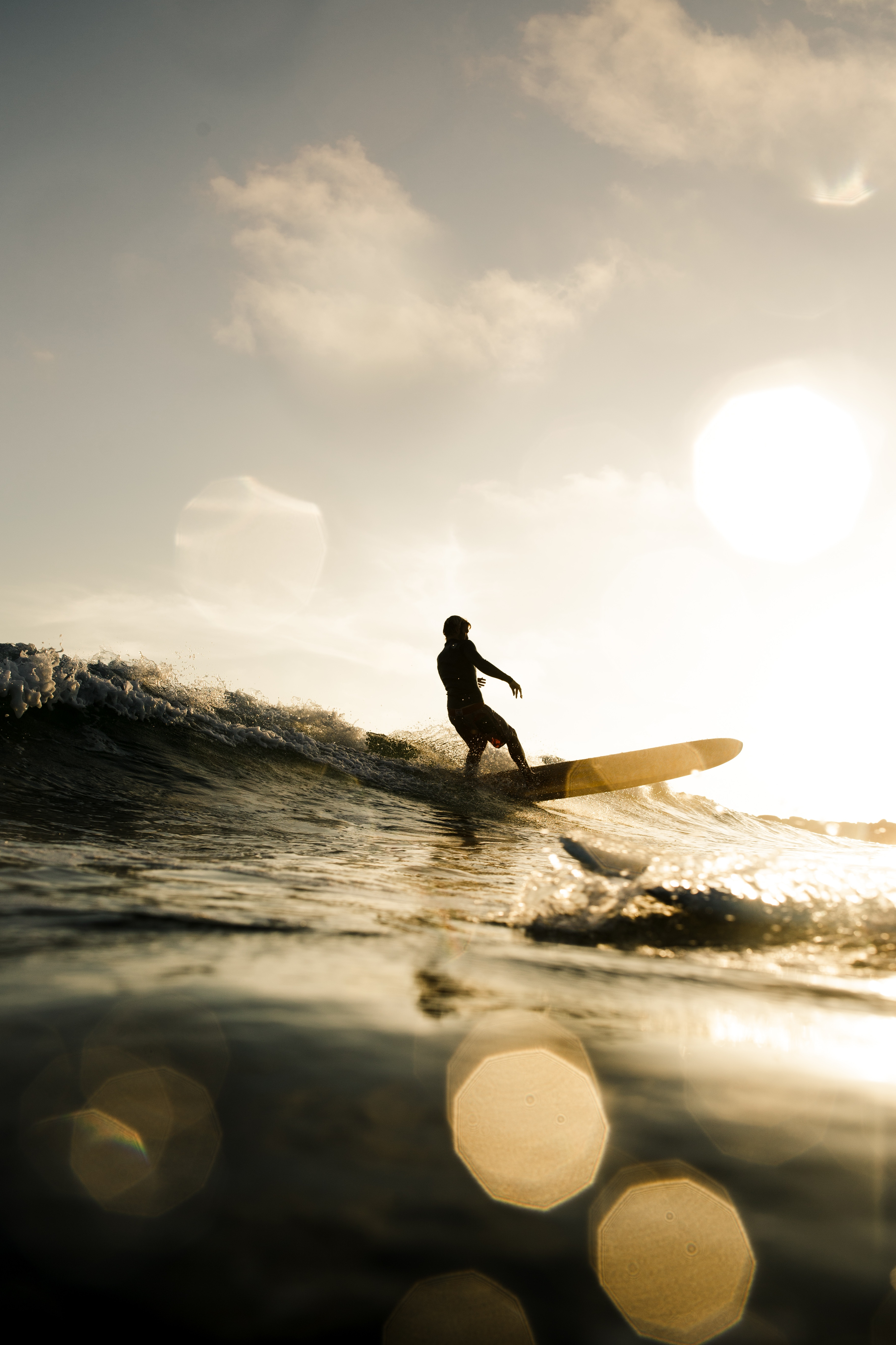 127762 download wallpaper Sports, Surfer, Serfing, Sunset, Glare, Bokeh, Boquet, Waves screensavers and pictures for free
