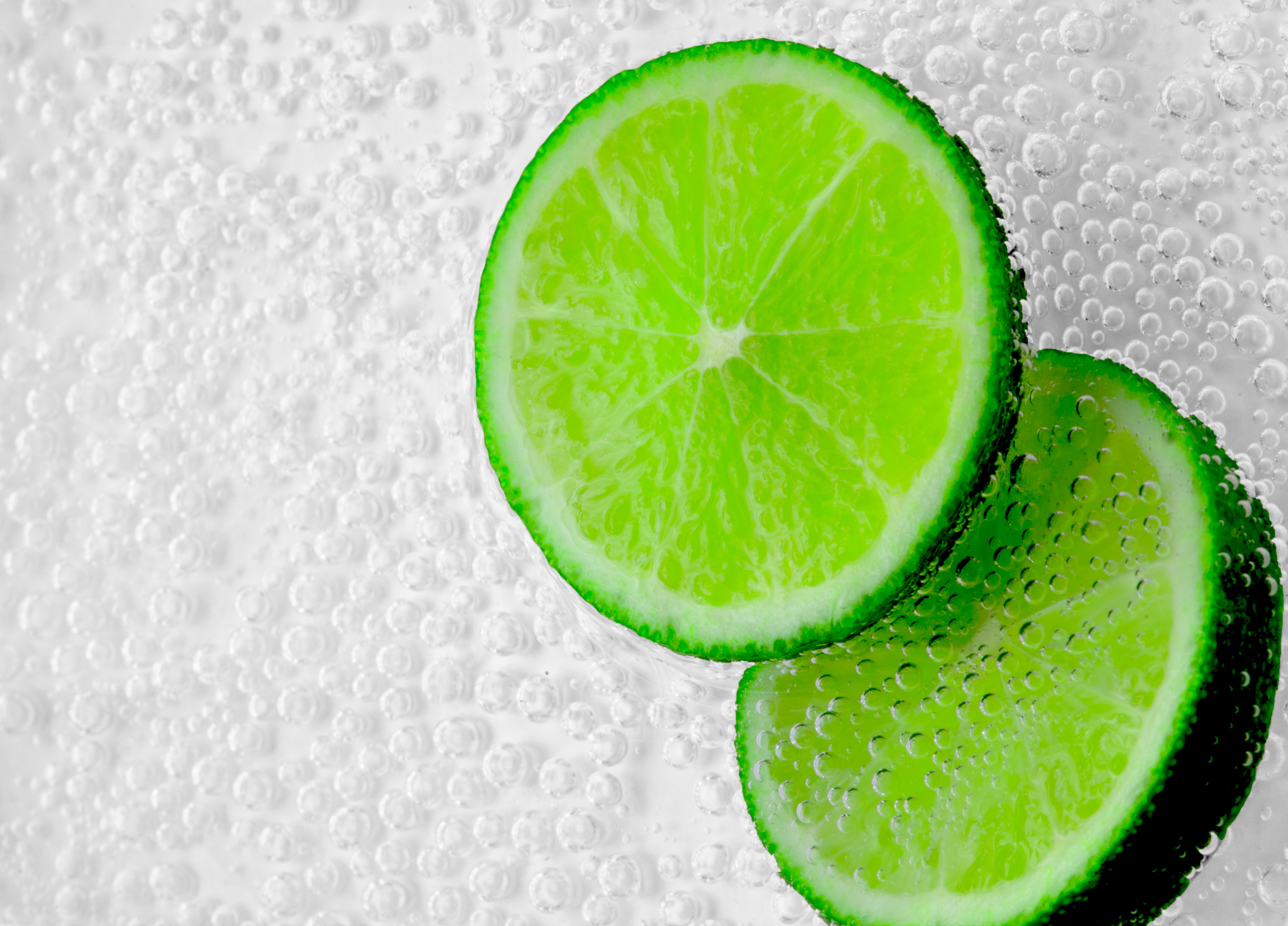 112855 download wallpaper Food, Bubbles, Lime, Lobules, Slices screensavers and pictures for free