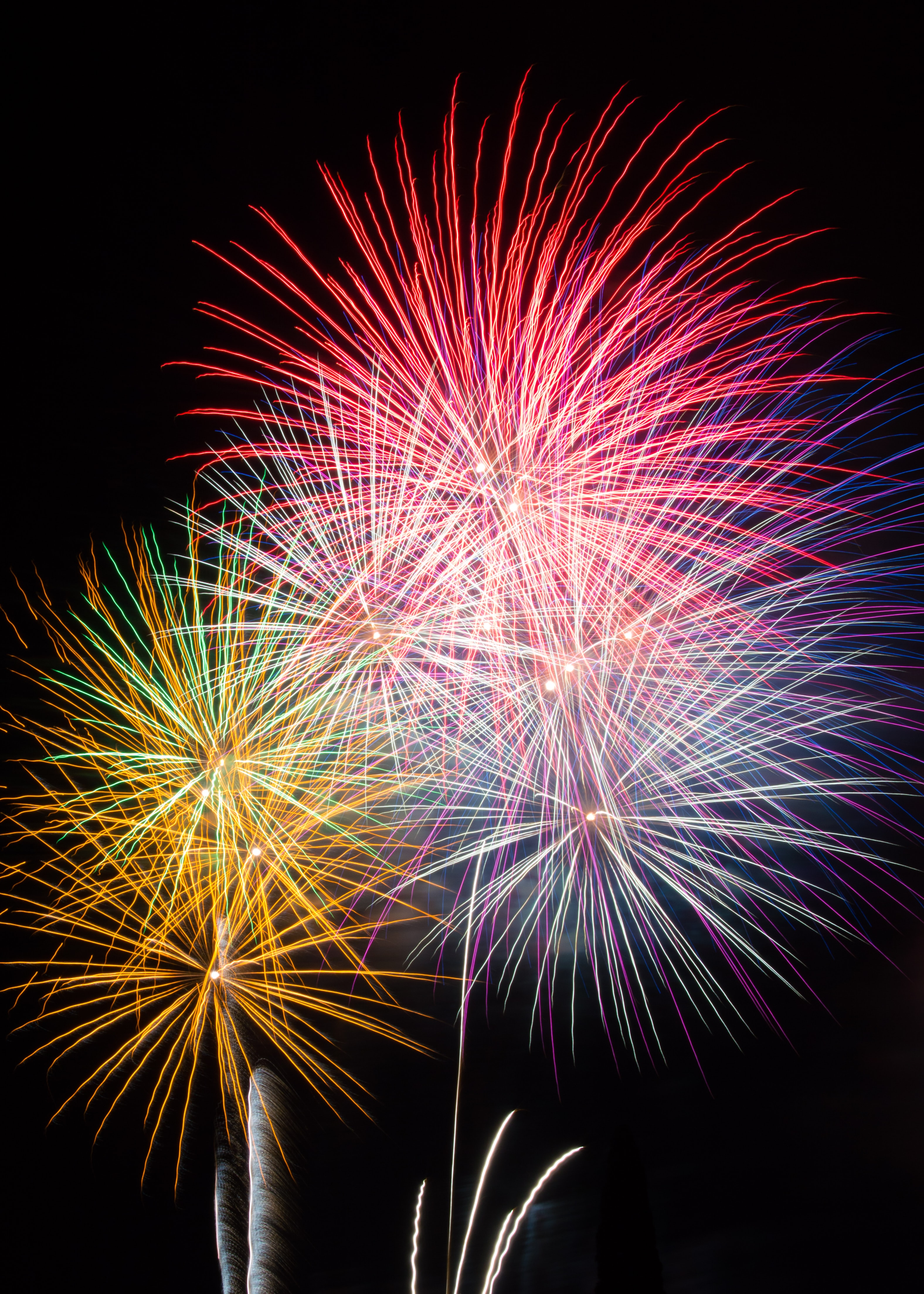 71366 download wallpaper Holidays, Night, Sparks, Multicolored, Motley, Holiday, Fireworks, Firework screensavers and pictures for free