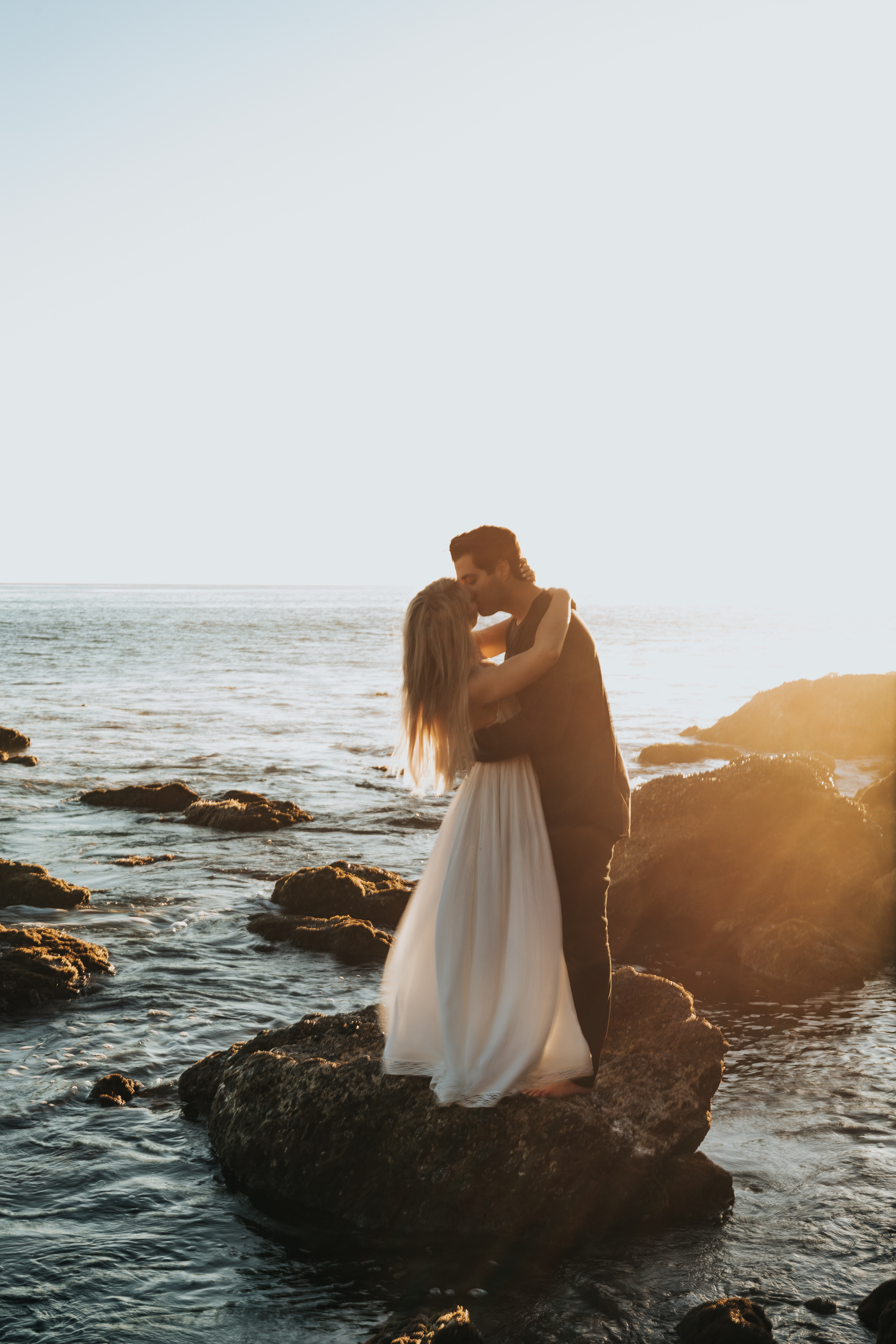 156086 download wallpaper Love, Couple, Pair, Kiss, Sunset, Sea, Tenderness, Romance screensavers and pictures for free