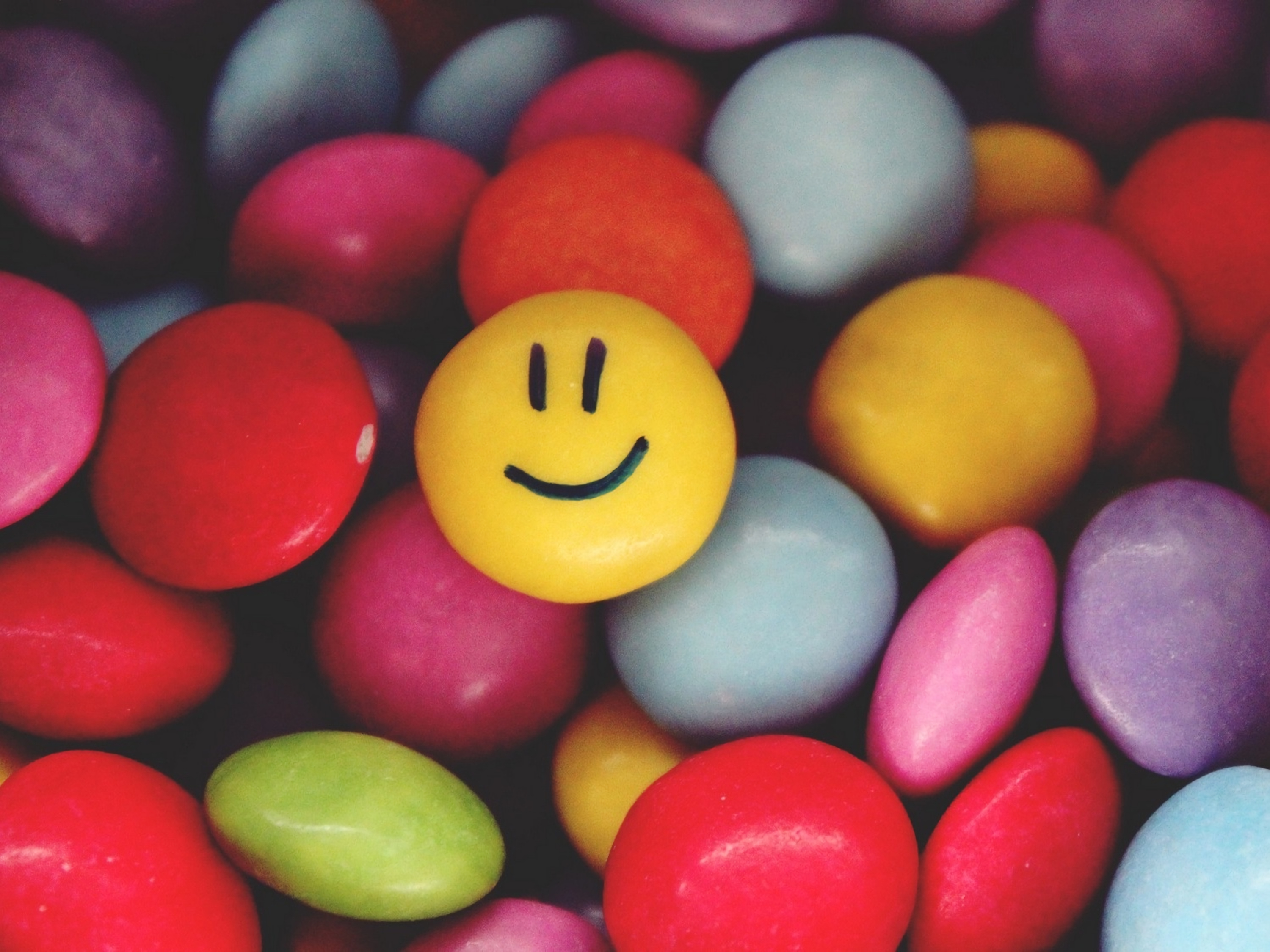 123936 Screensavers and Wallpapers Smile for phone. Download Candies, Miscellanea, Miscellaneous, Multicolored, Motley, Smile, Emoticon, Smiley pictures for free