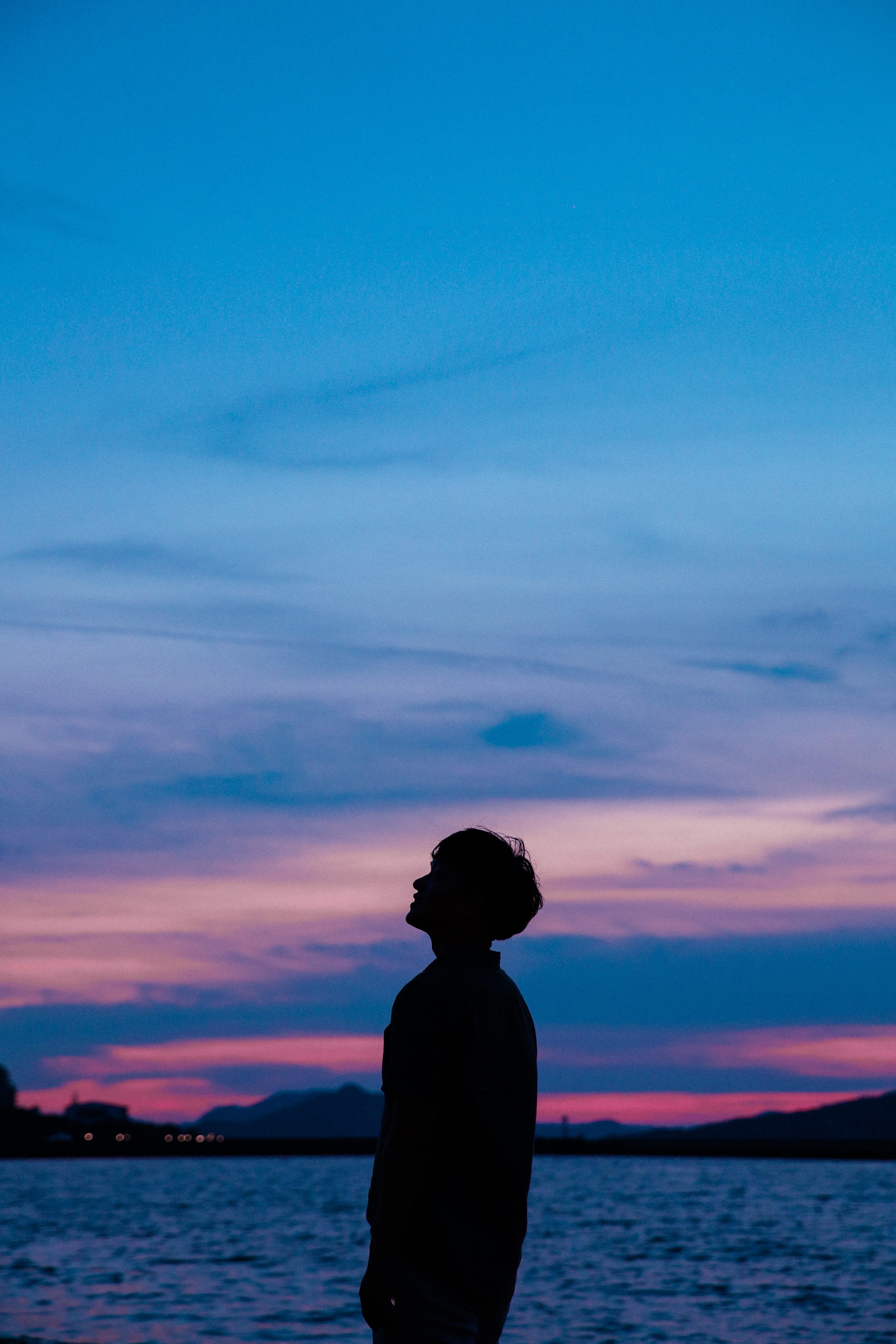 97832 download wallpaper Dark, Guy, Silhouette, Sunset, Sky, Sea screensavers and pictures for free
