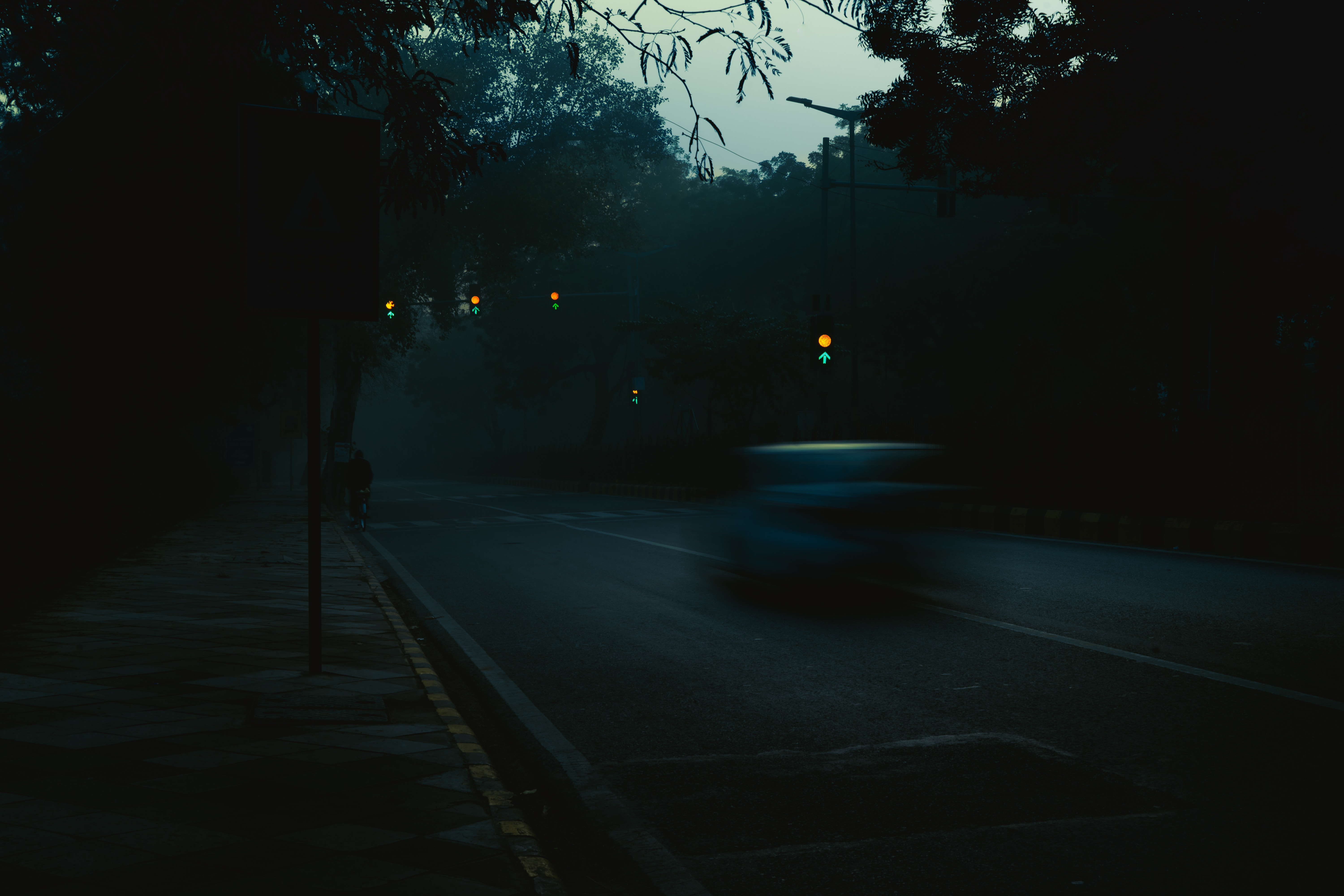 66961 download wallpaper Dark, Car, Silhouette, Traffic, Movement, Gloomy screensavers and pictures for free