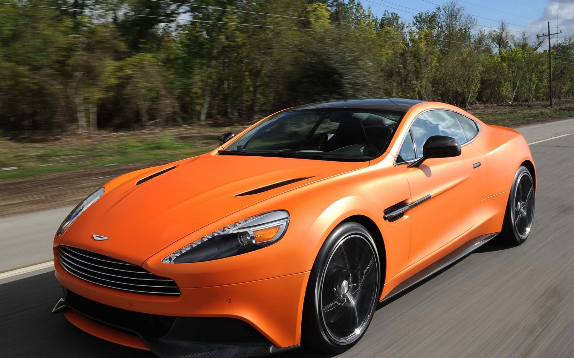 89794 Screensavers and Wallpapers Aston Martin for phone. Download Aston Martin, Cars, Front View, Speed, Vanquish Orange pictures for free