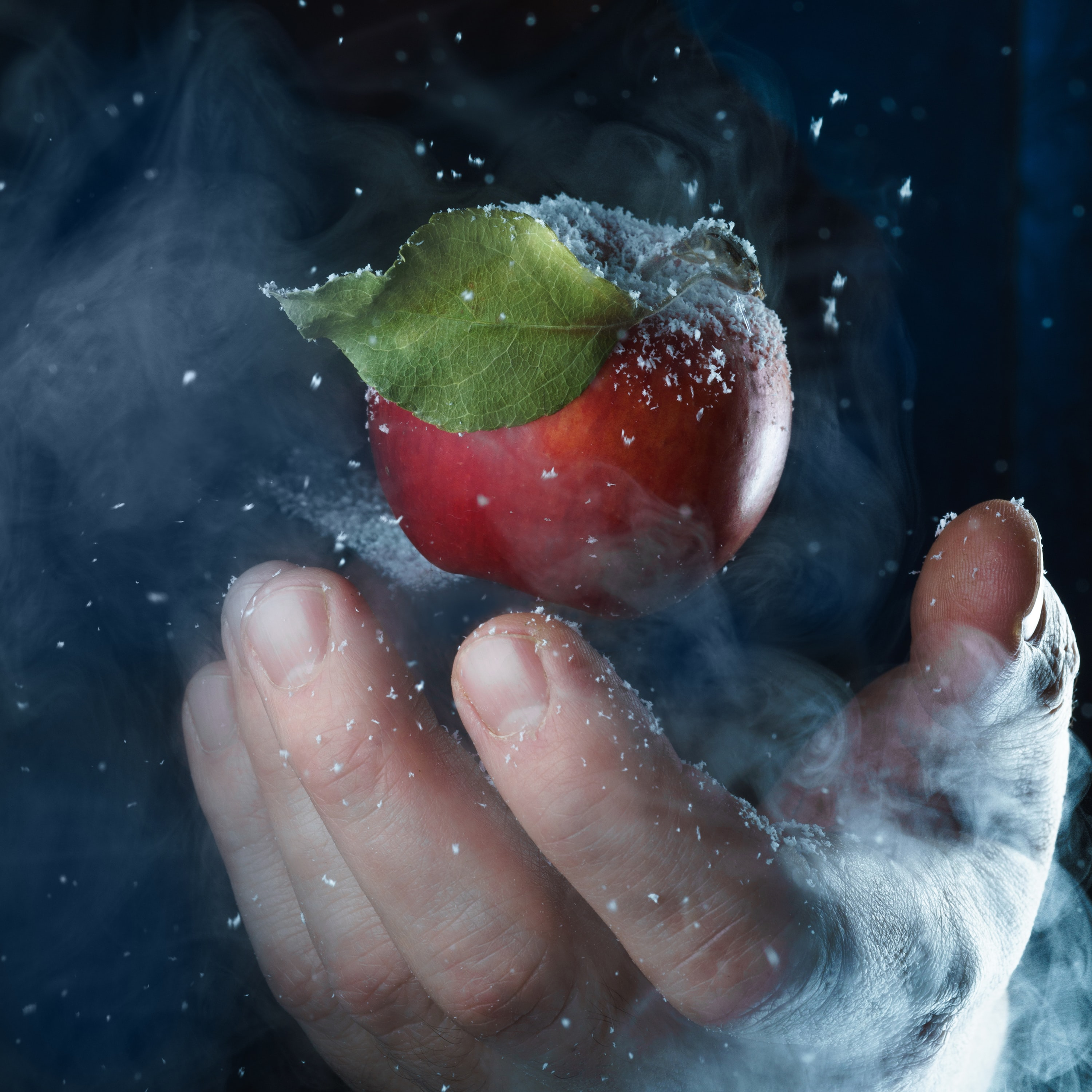 147766 download wallpaper Food, Apple, Hand, Snow, Steam screensavers and pictures for free