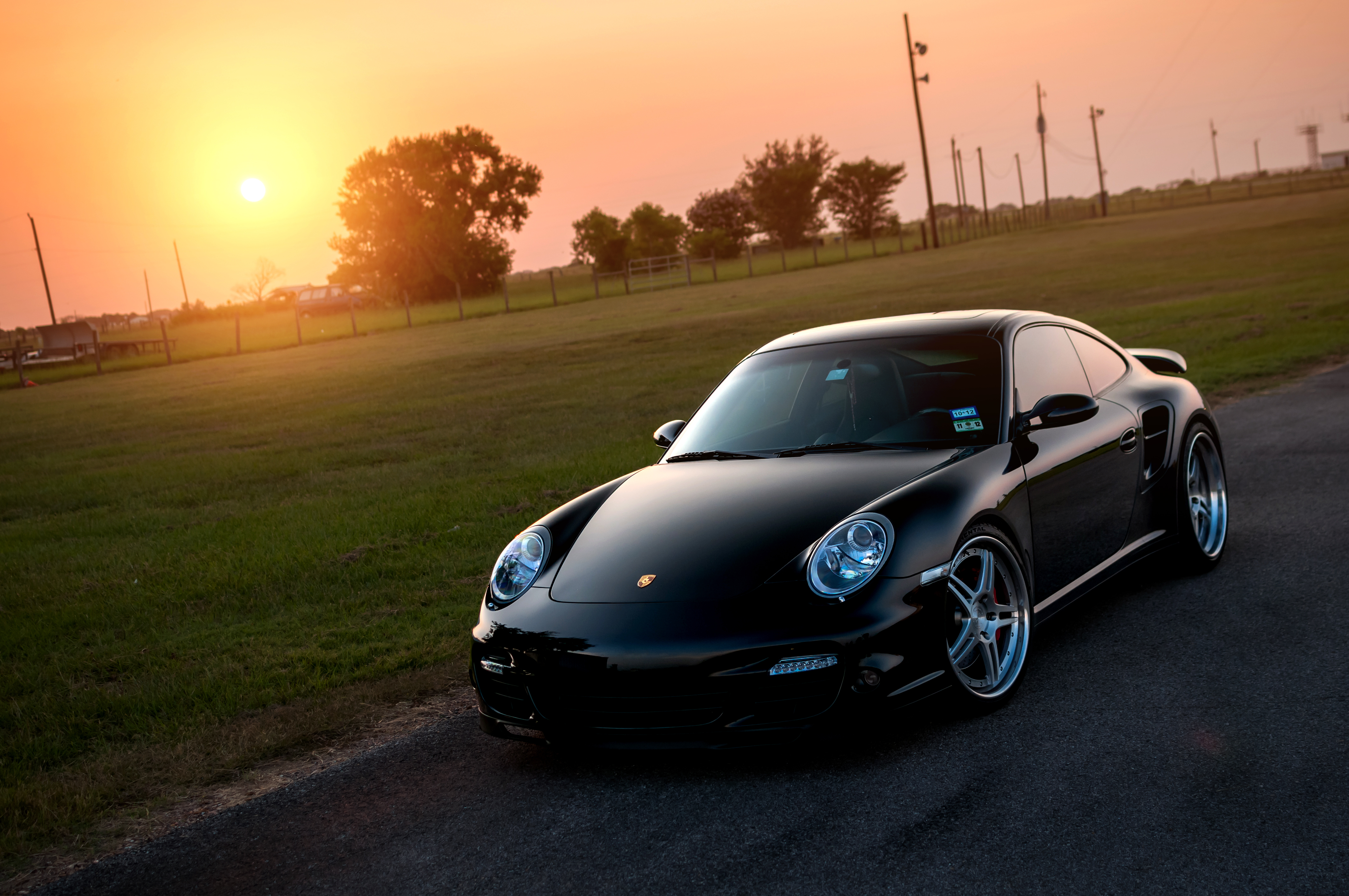 102207 download wallpaper Porsche, Sun, Cars, Glare, Lawn, 911, 997, Front, Turbo screensavers and pictures for free