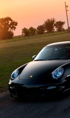 102207 Заставки и Обои Солнце на телефон. Скачать Тачки (Cars), Порш (Porsche), 911, Турбо, 997, Front, Порше, Чёрный, Газон, Блики, Солнце картинки бесплатно