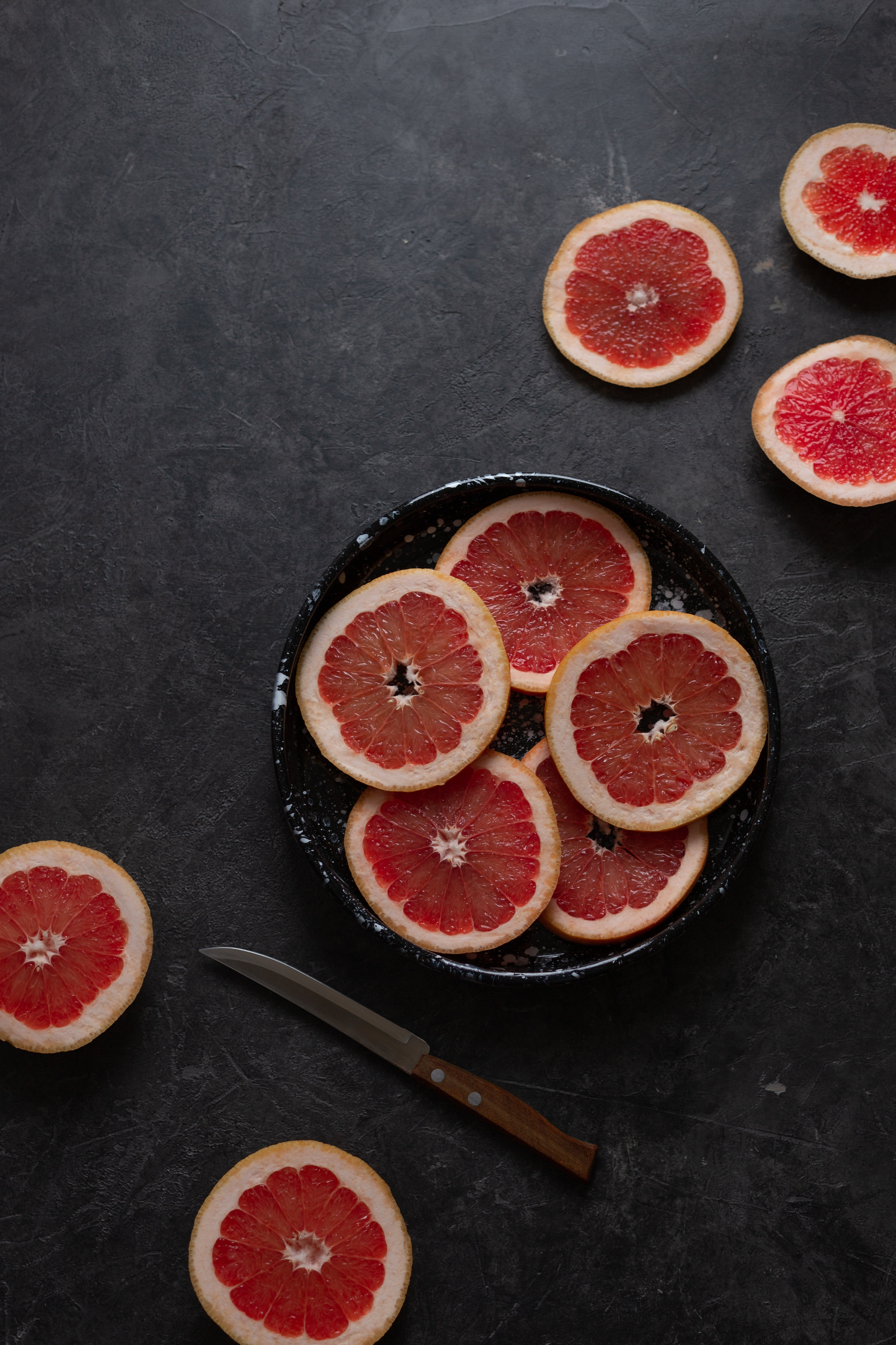 127591 Screensavers and Wallpapers Still Life for phone. Download Food, Still Life, Fruit, Lobules, Slices, Grapefruit pictures for free