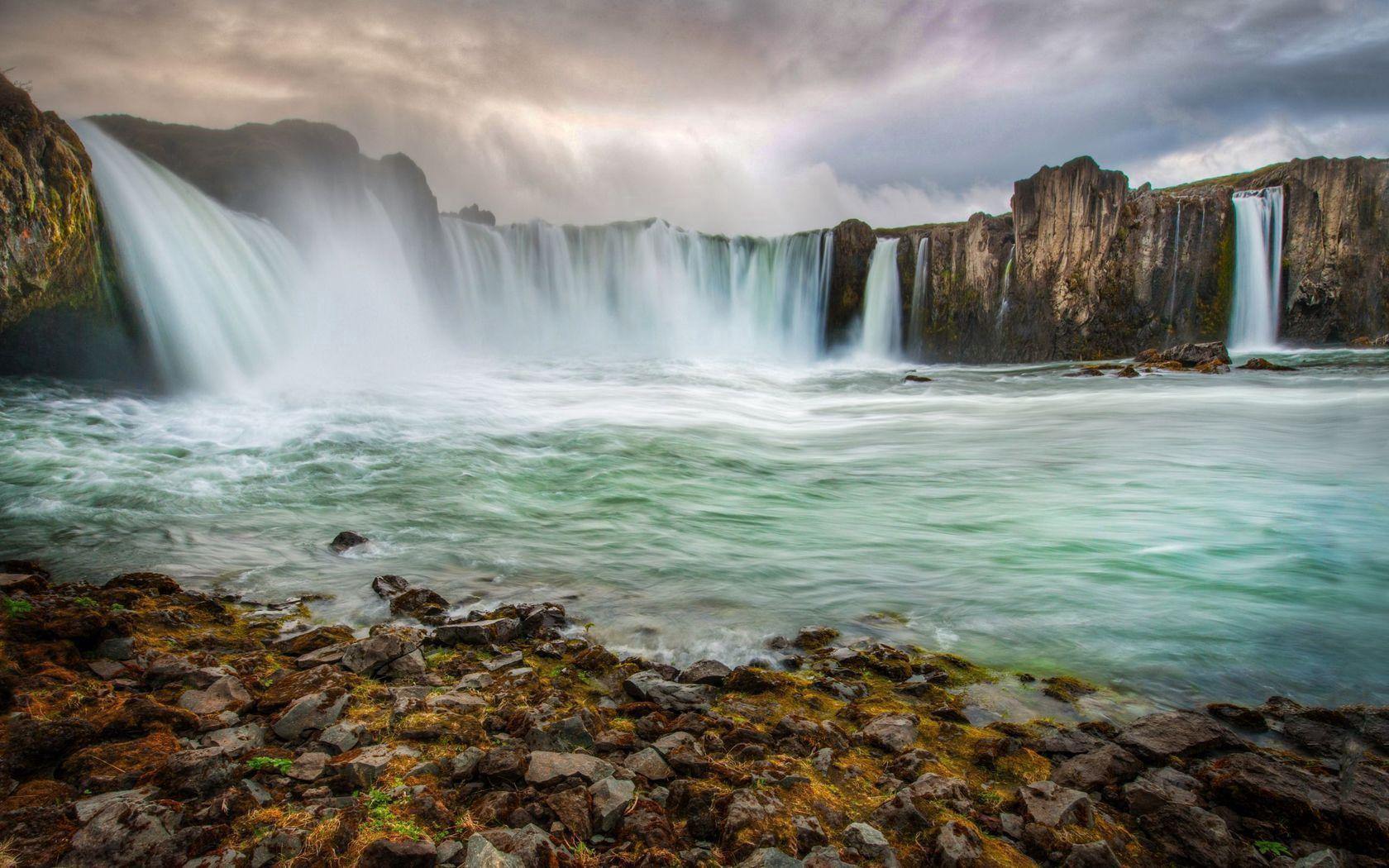 119165 Hintergrundbild herunterladen Wasserfälle, Natur, Stones, Felsen, Die Steine, Hauptsächlich Bewölkt, Bedeckt, Island, Streams, Fließt - Bildschirmschoner und Bilder kostenlos