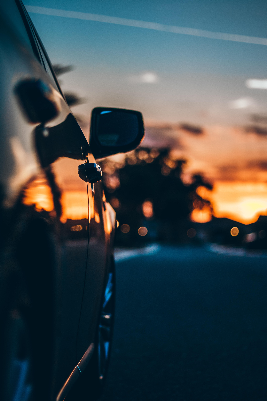 90927 papel de parede 1080x2400 em seu telefone gratuitamente, baixe imagens Pôr Do Sol, Carros, Carro, Tráfego, Movimento, Borrão De Espelho 1080x2400 em seu celular