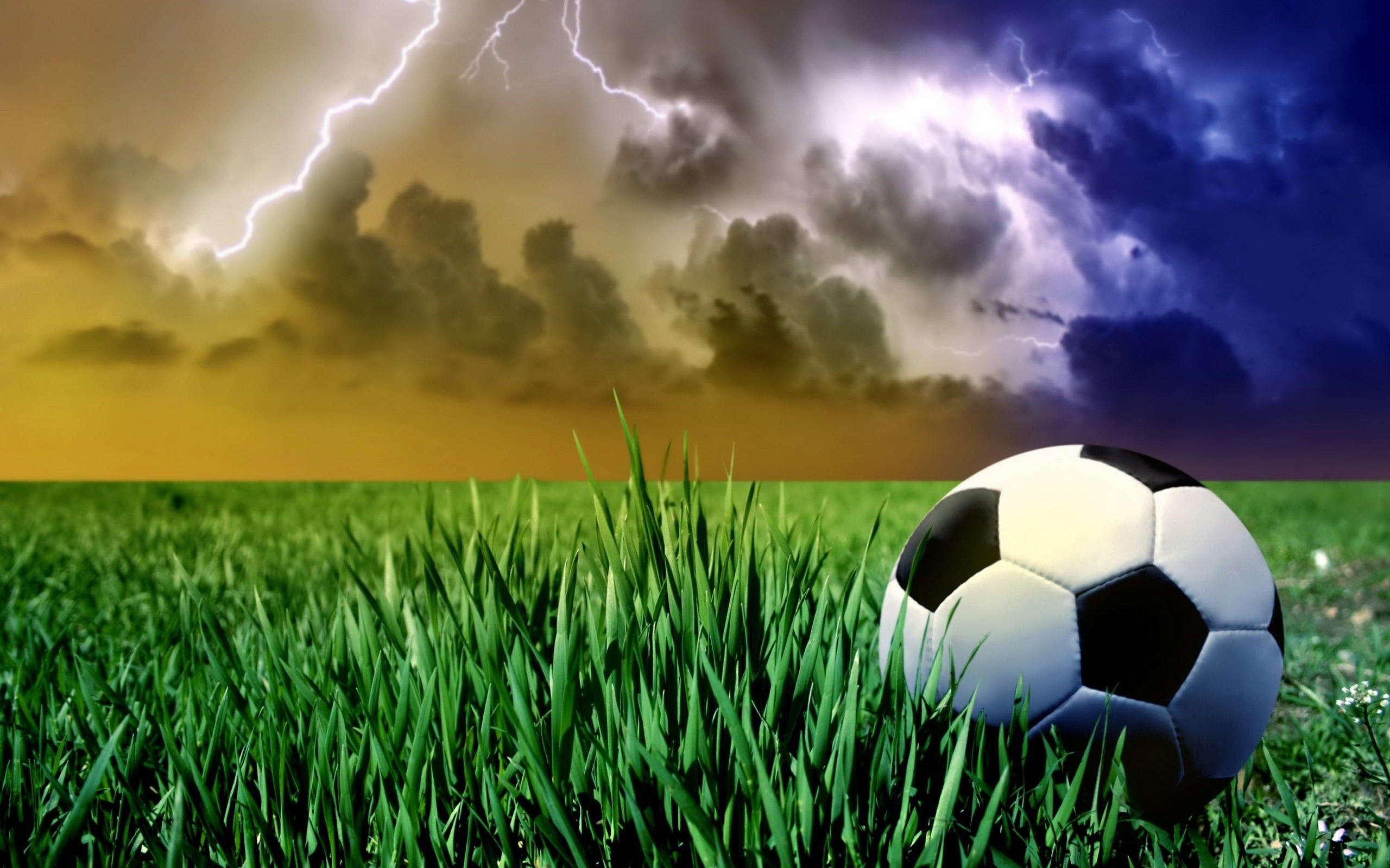 22625 download wallpaper Sports, Landscape, Grass, Sky, Football, Clouds, Lightning screensavers and pictures for free
