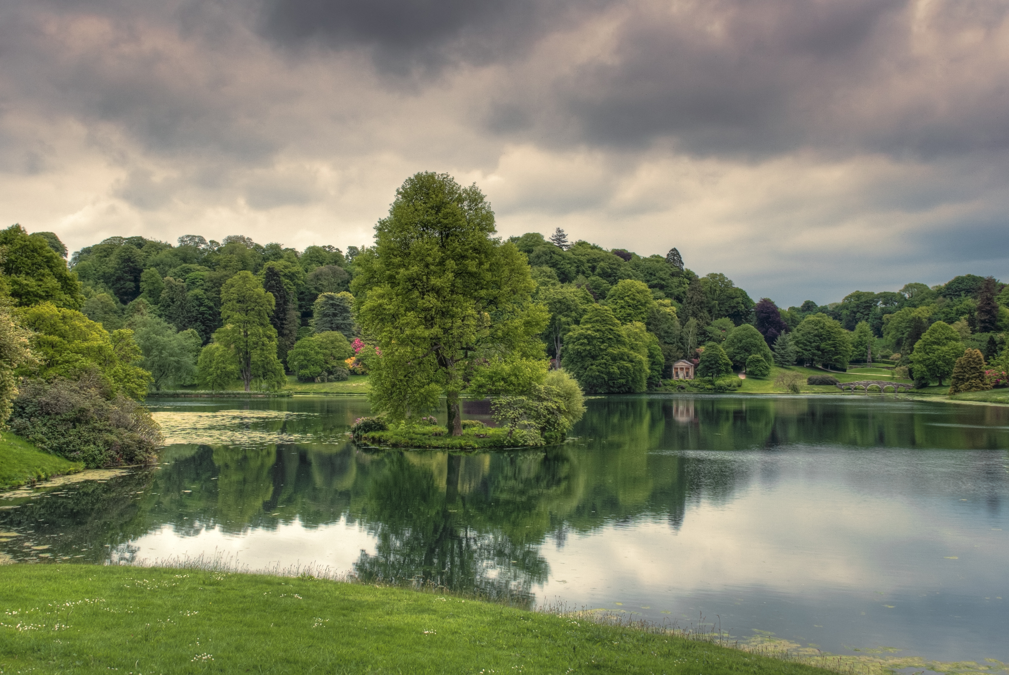 107517 download wallpaper Lake, Nature, Trees, Grass, Reflection, Cloudy screensavers and pictures for free