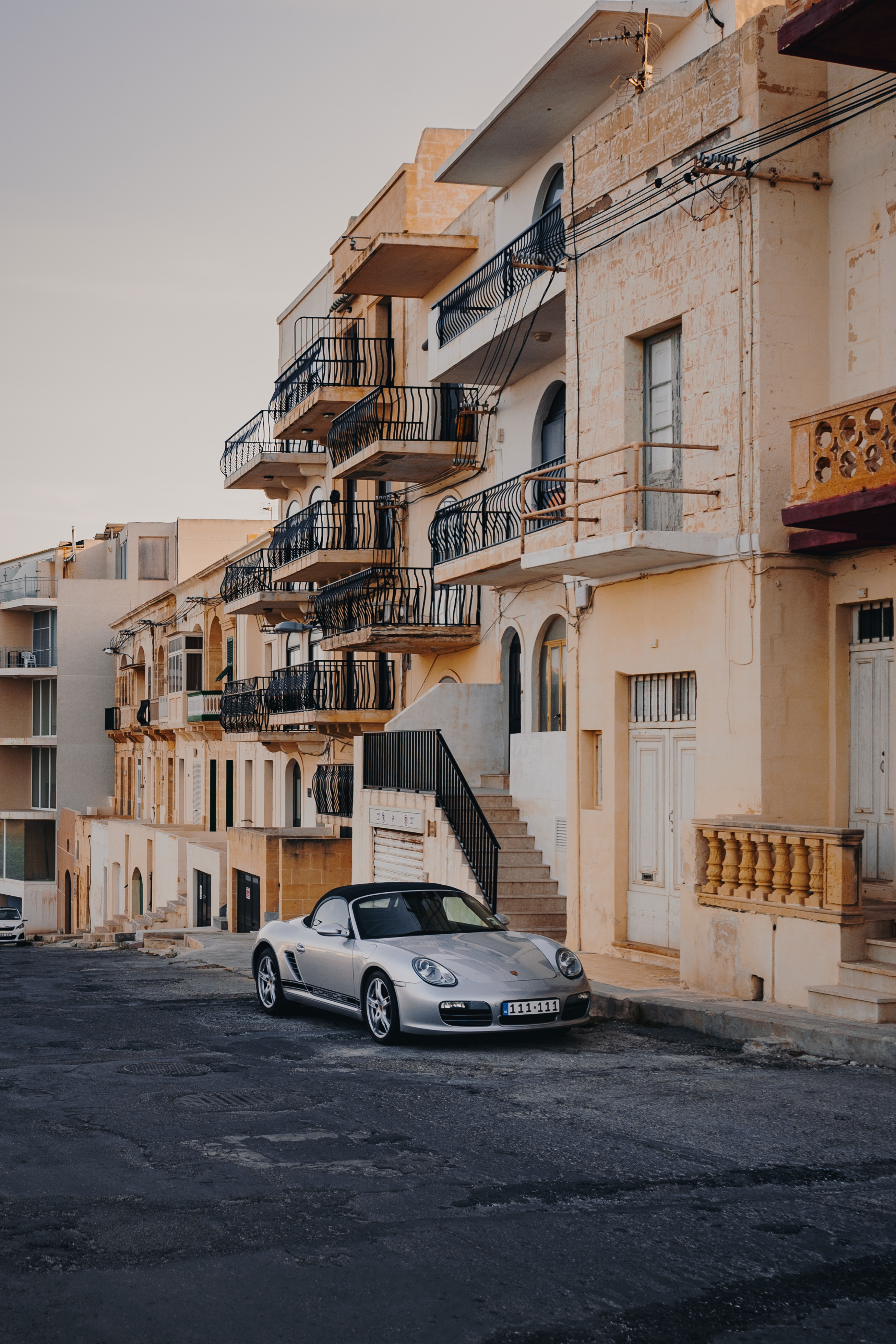 126707 download wallpaper Porsche, Sports, Cars, Building, Sports Car, Facade, Street, Malta, Marsalforn screensavers and pictures for free