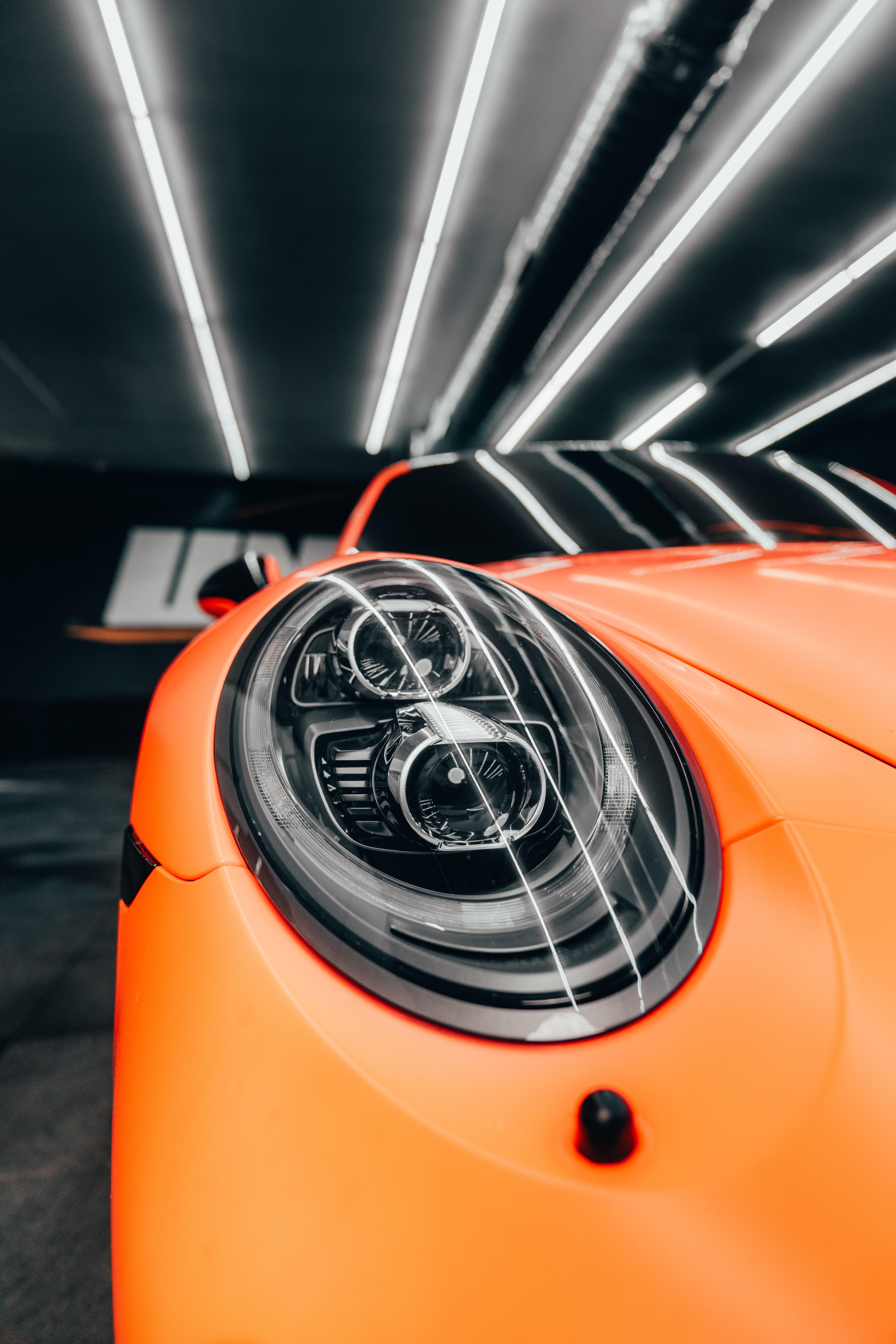 155590 Заставки и Обои Порш (Porsche) на телефон. Скачать Порш (Porsche), Тачки (Cars), Автомобиль, Вид Спереди, Оранжевый, Фара картинки бесплатно