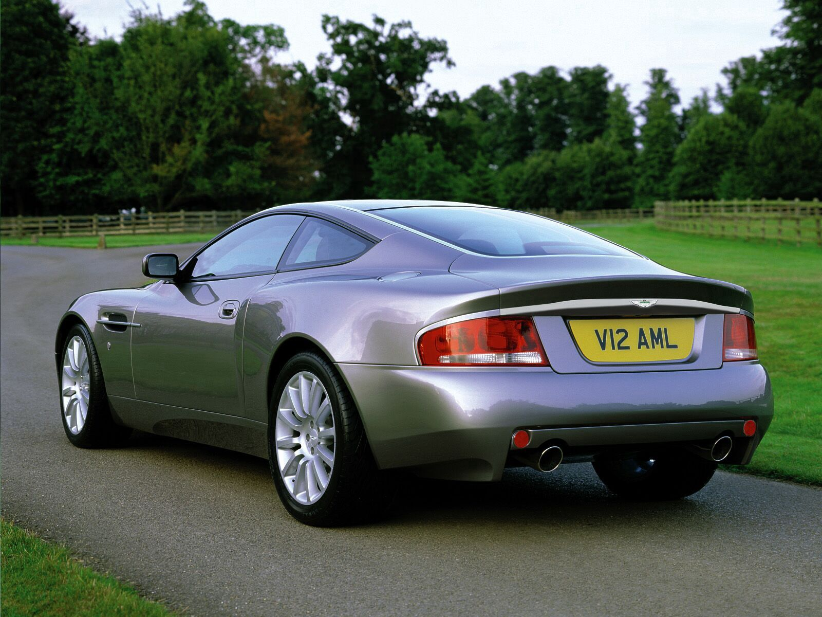 152727 Screensavers and Wallpapers Aston Martin for phone. Download Auto, Nature, Aston Martin, Cars, Grey, Back View, Rear View, V12, Vanquish, 2001 pictures for free