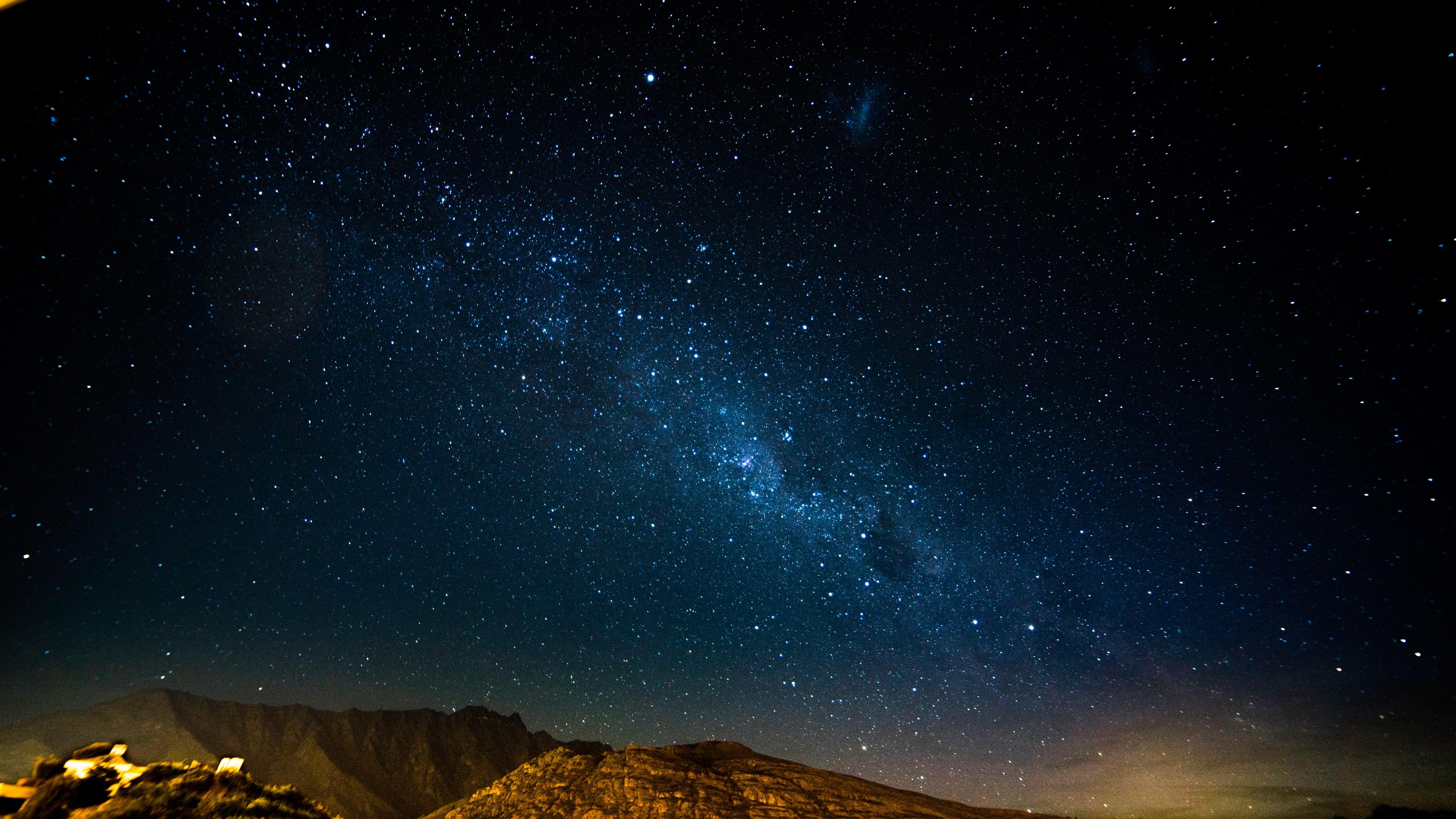 74024 скачать обои Горы, Природа, Звездное Небо, Ночь, Сияние, Блеск - заставки и картинки бесплатно
