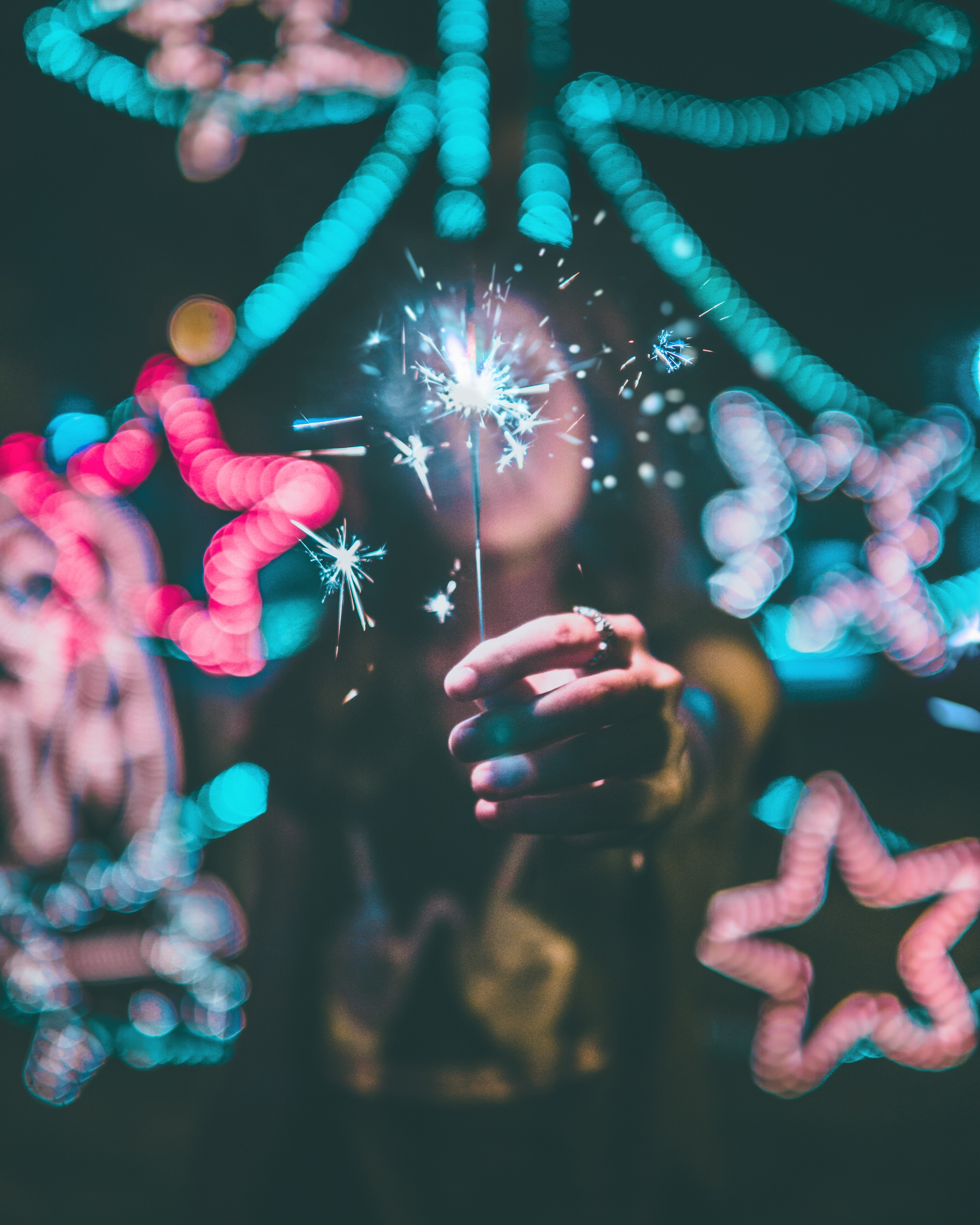 51604 Screensavers and Wallpapers Hand for phone. Download Holidays, Sparkler, Hand, Glare, Neon, Shine, Brilliance, Sparks pictures for free