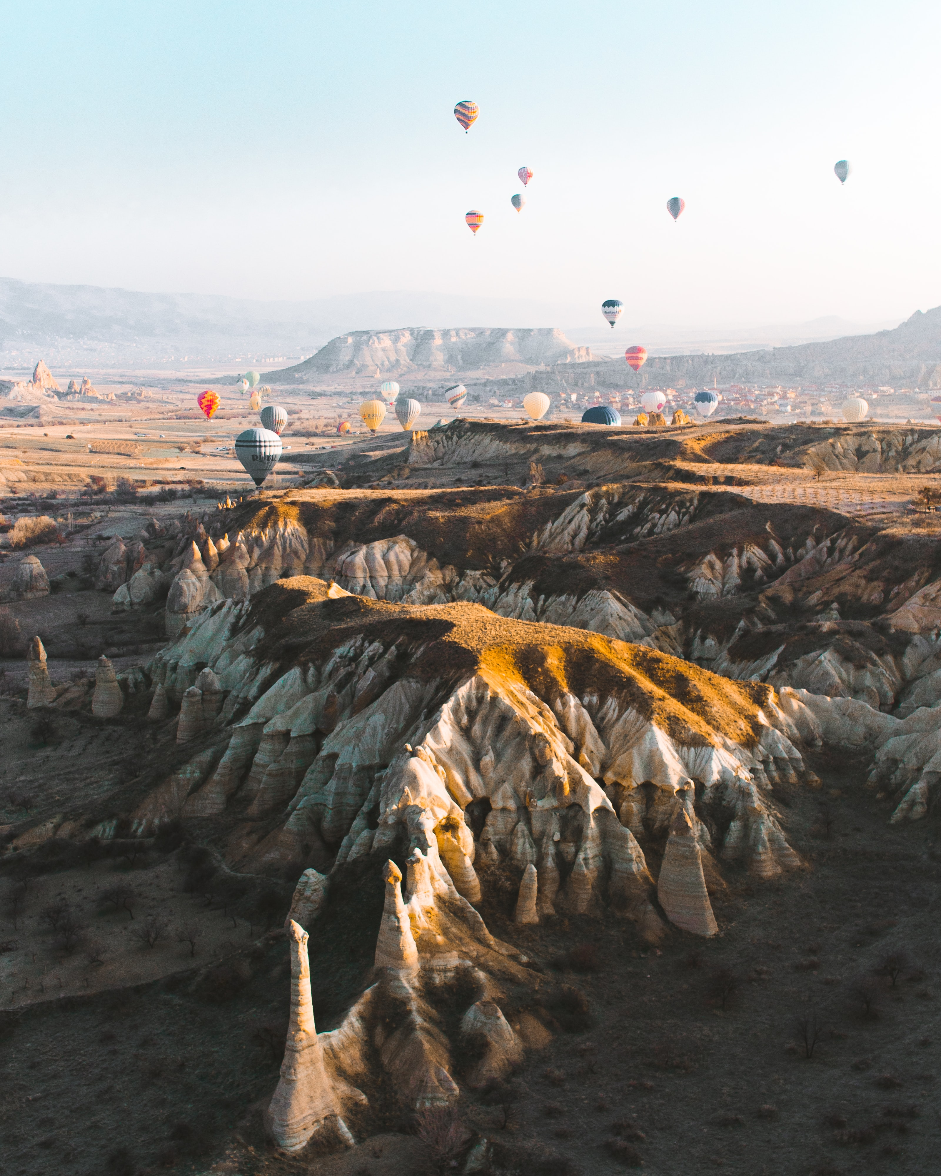136220 Screensavers and Wallpapers Balloons for phone. Download Mountains, Balloons, Rocks, Miscellanea, Miscellaneous, Multicolored, Motley, Valley pictures for free
