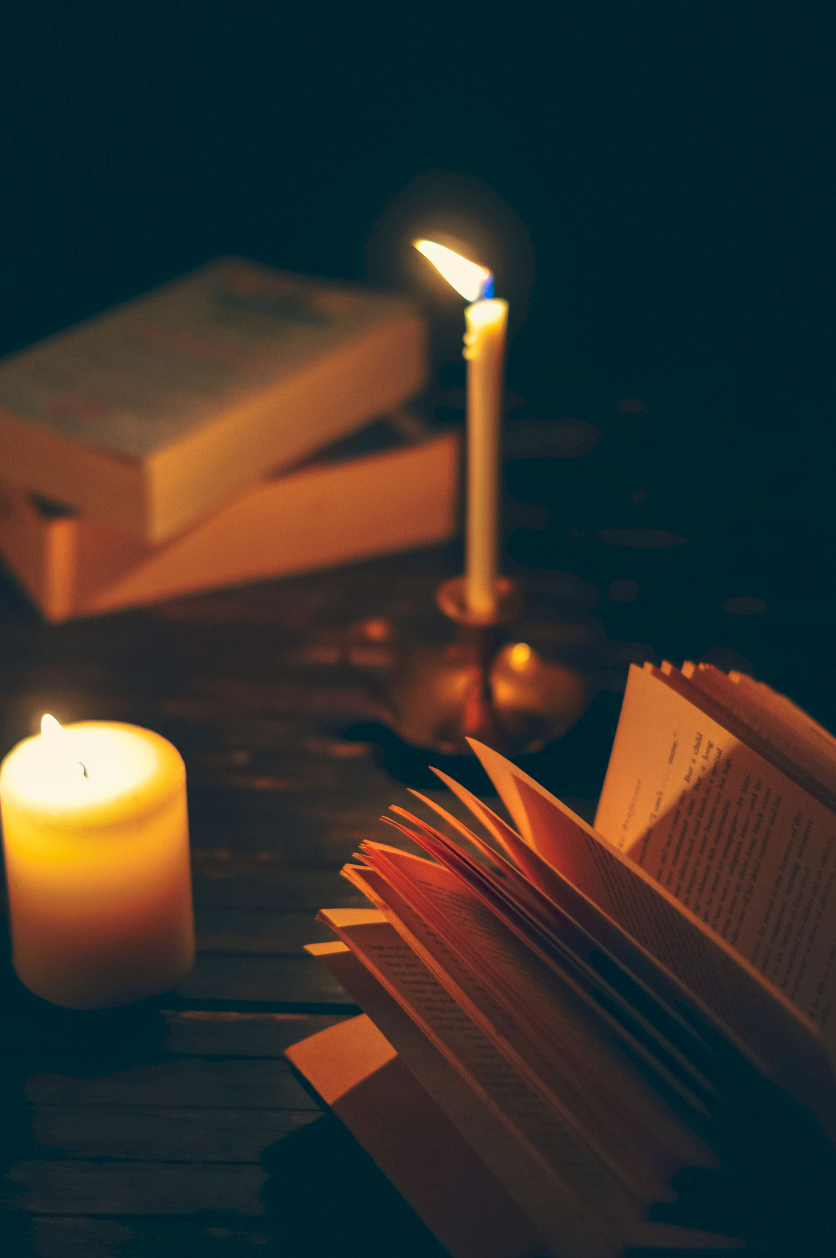 103791 Screensavers and Wallpapers Book for phone. Download Dark, Book, Shadows, Coziness, Comfort, Candle, Reading pictures for free